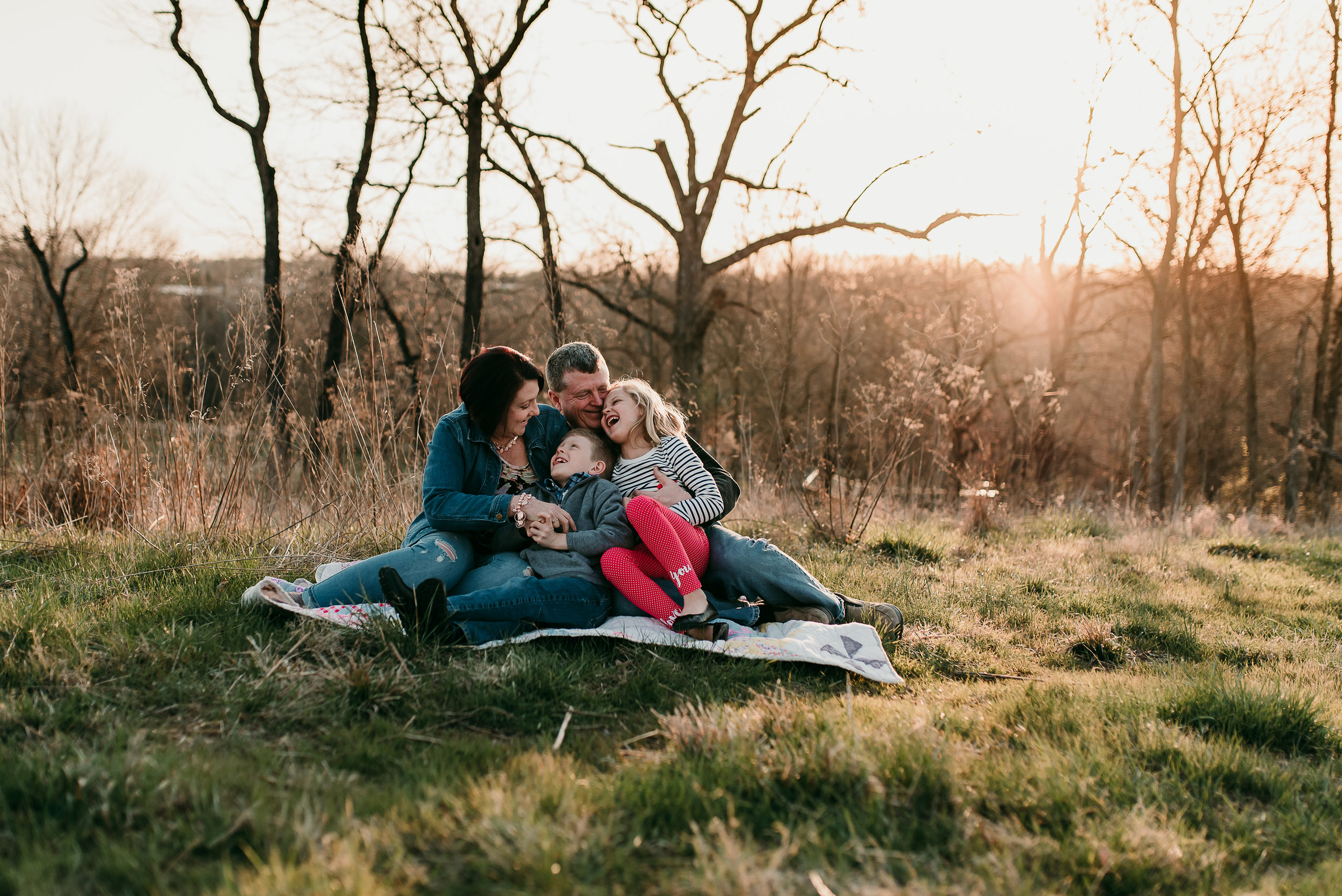 family snuggling in the sunset- St. Louis photographer
