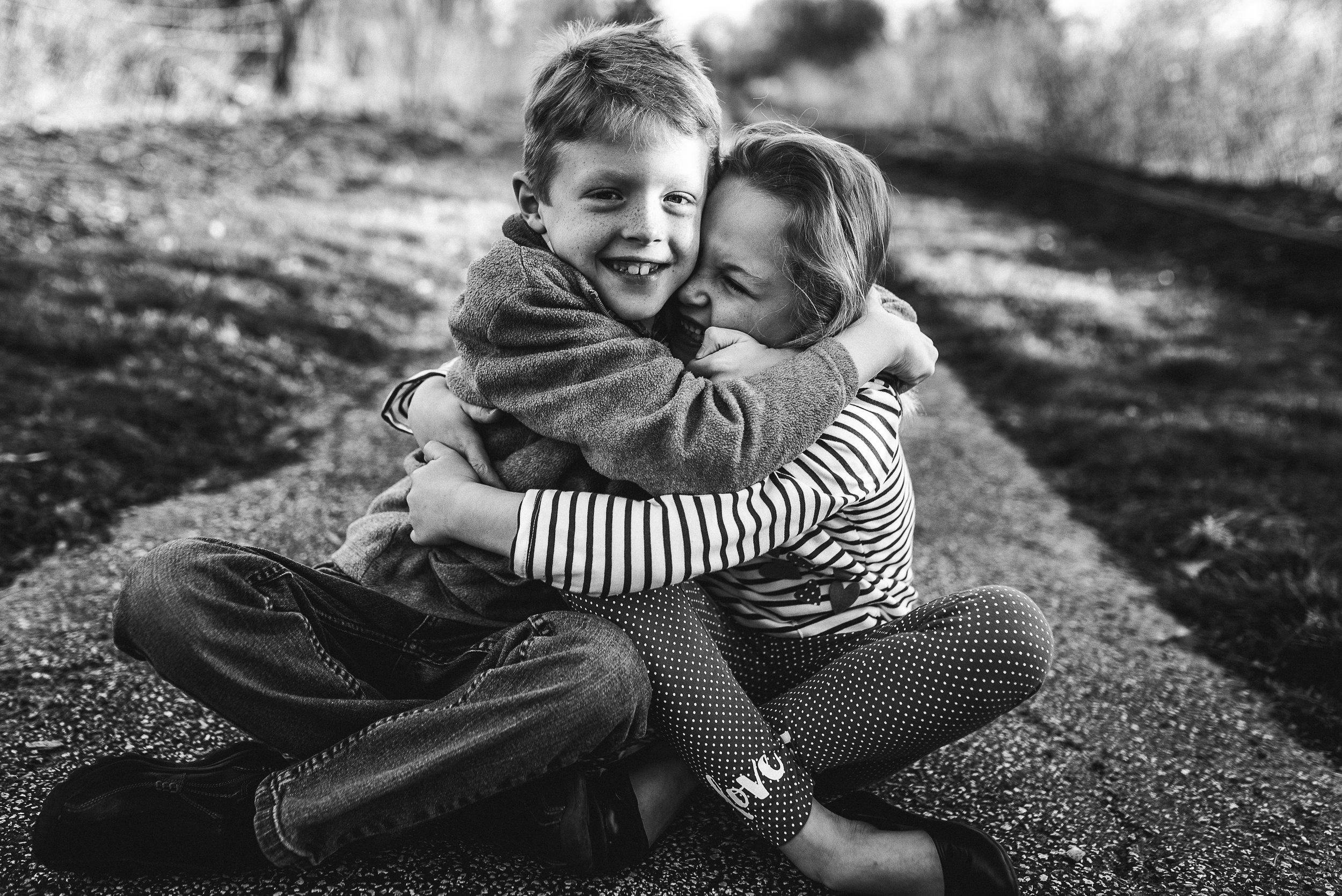 siblings hugging each other | St. Louis lifestyle photographer