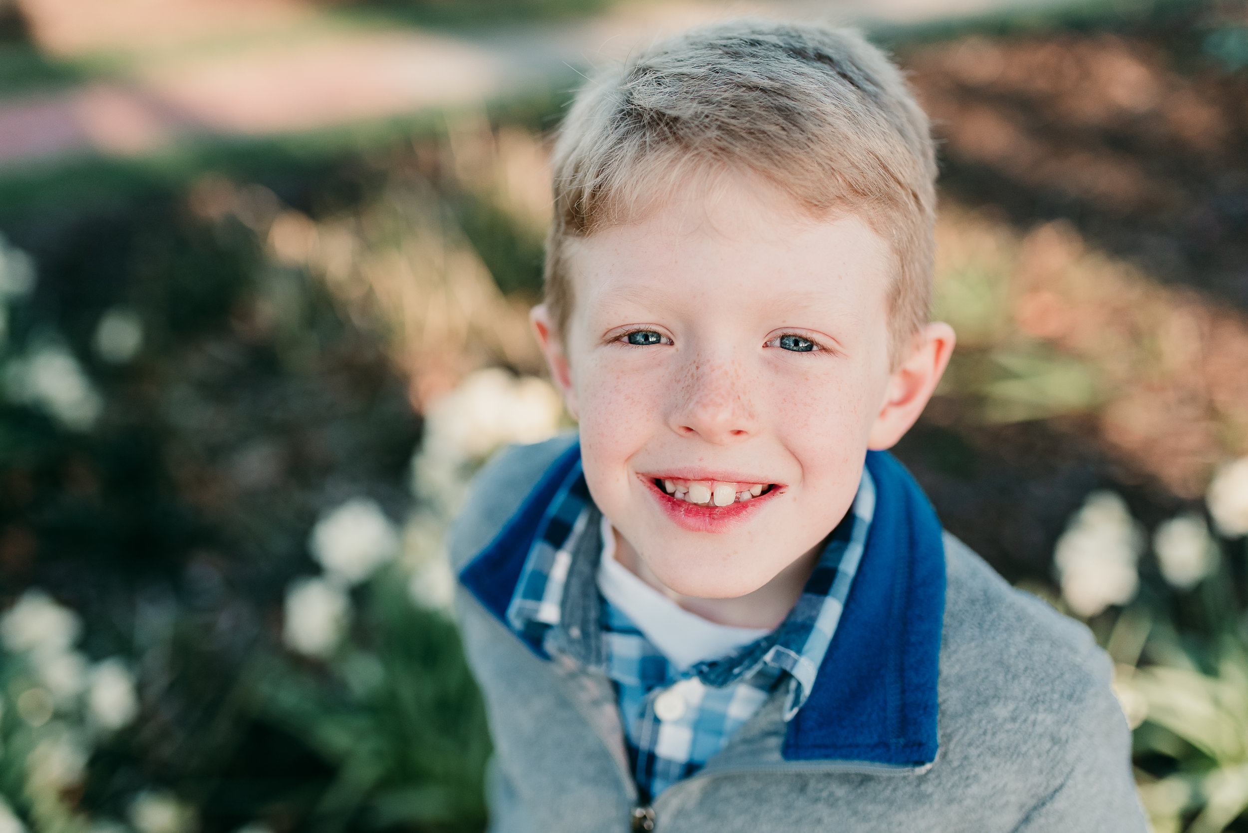 young boy smiling| St. Louis Family photographer