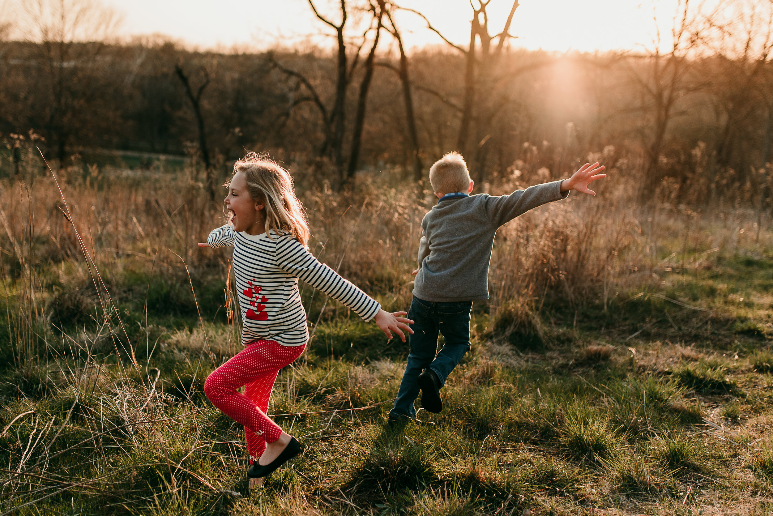 siblings dancing together in sunset light