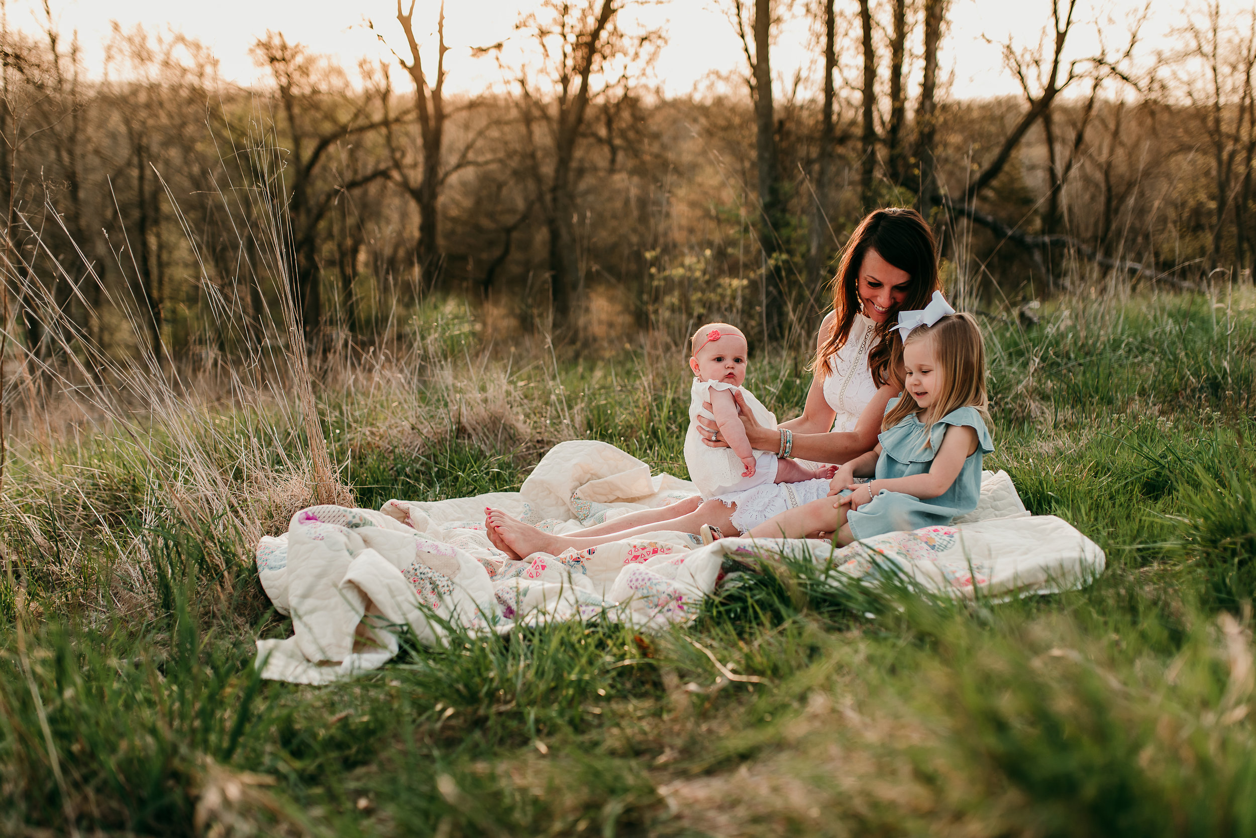 girls talking in field at sunset | St. Louis Photographer