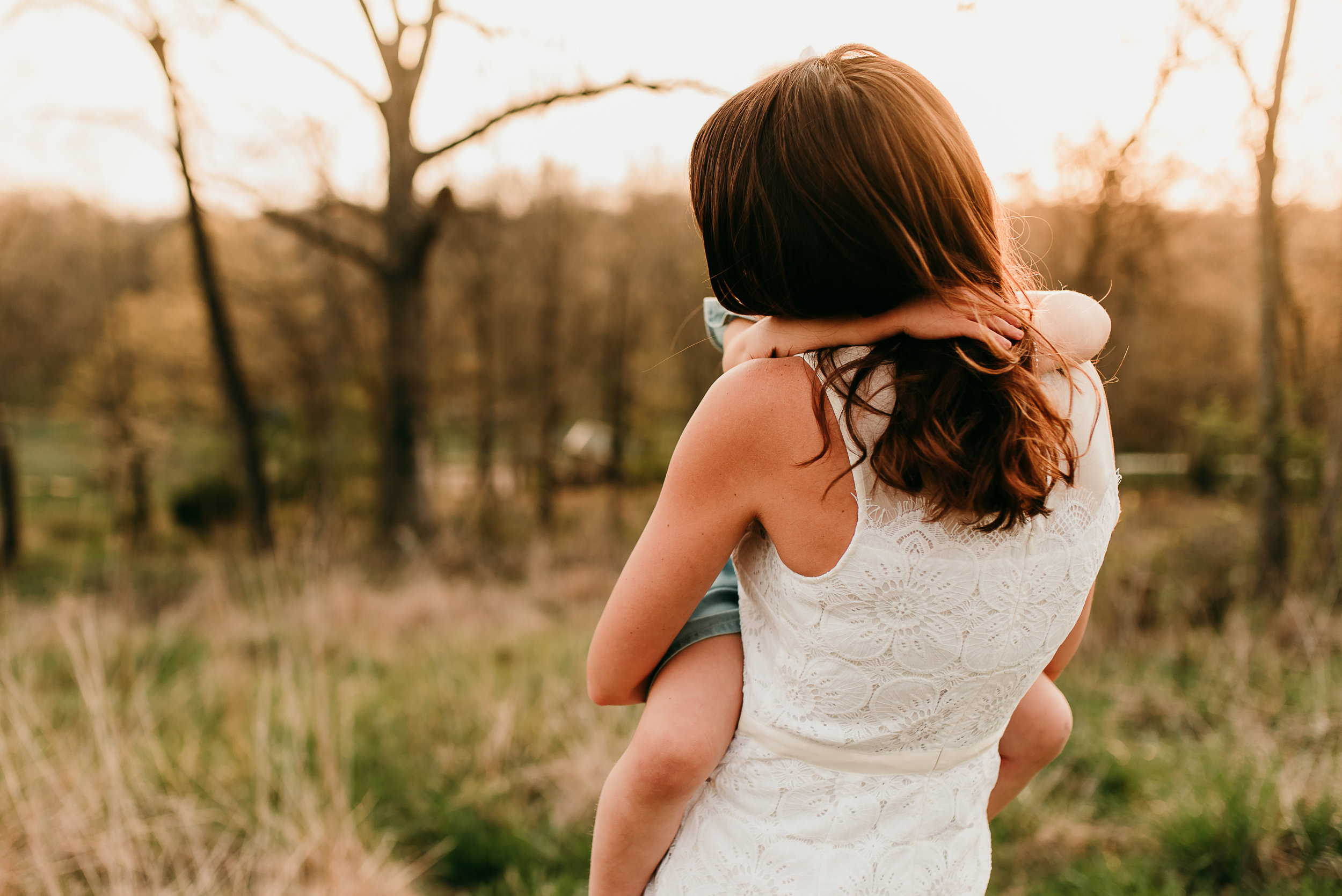 daughter hugging mother | St. Louis Family Photographer