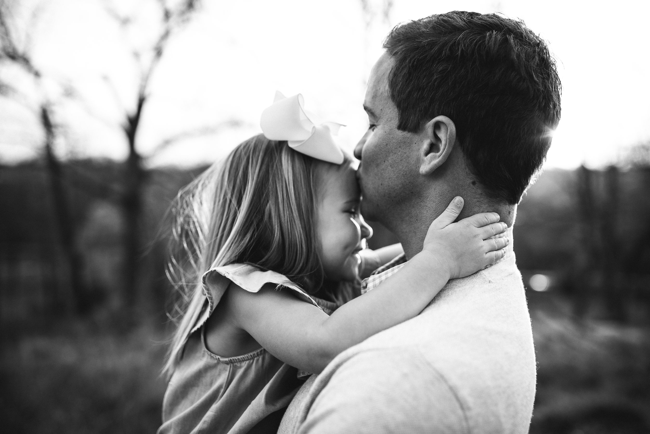 dad holding toddler daughter