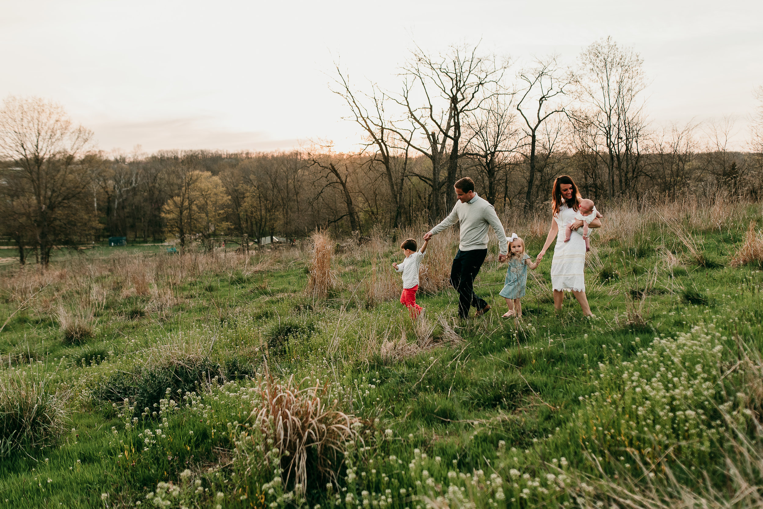 family walking in field