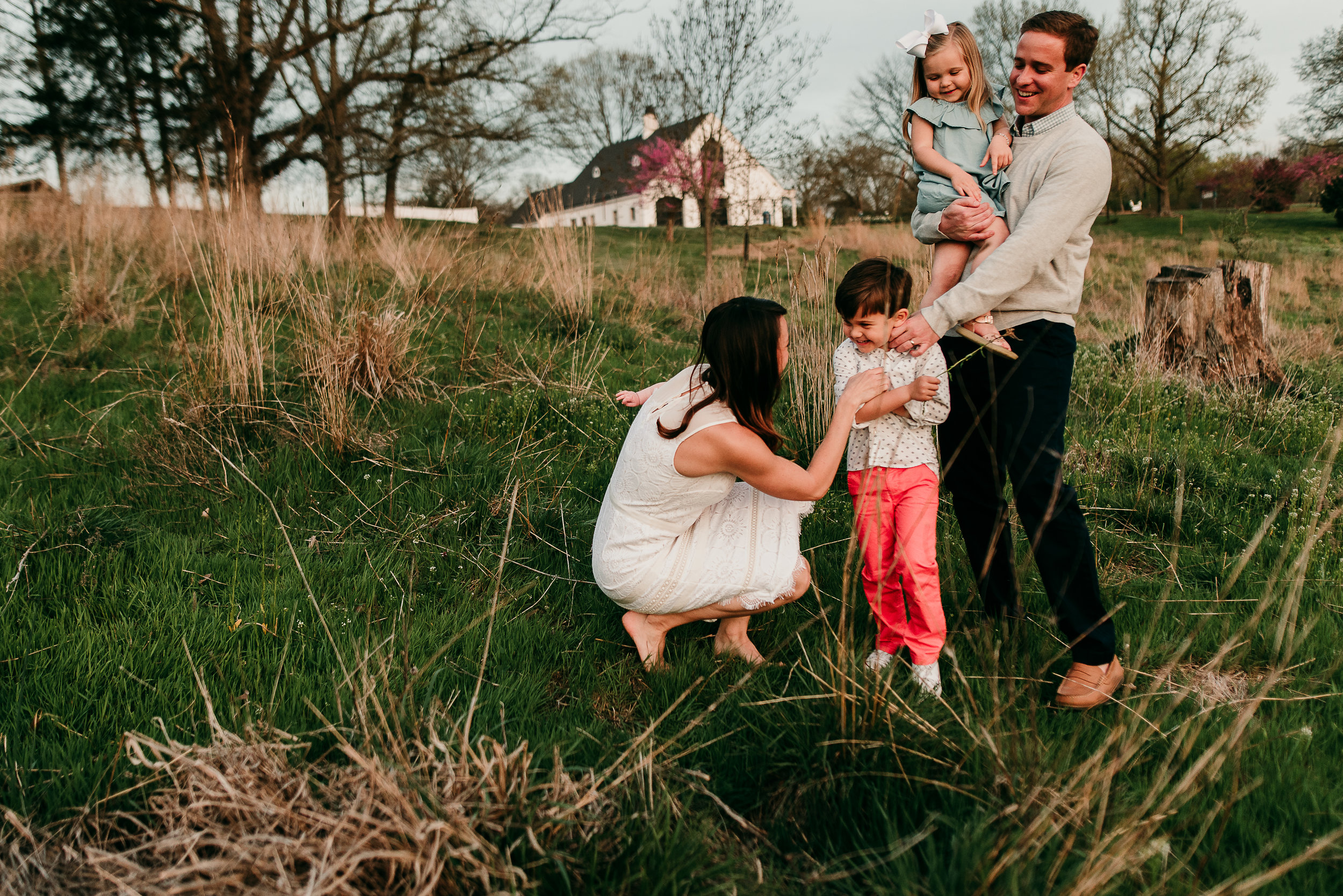 family laughing together in field