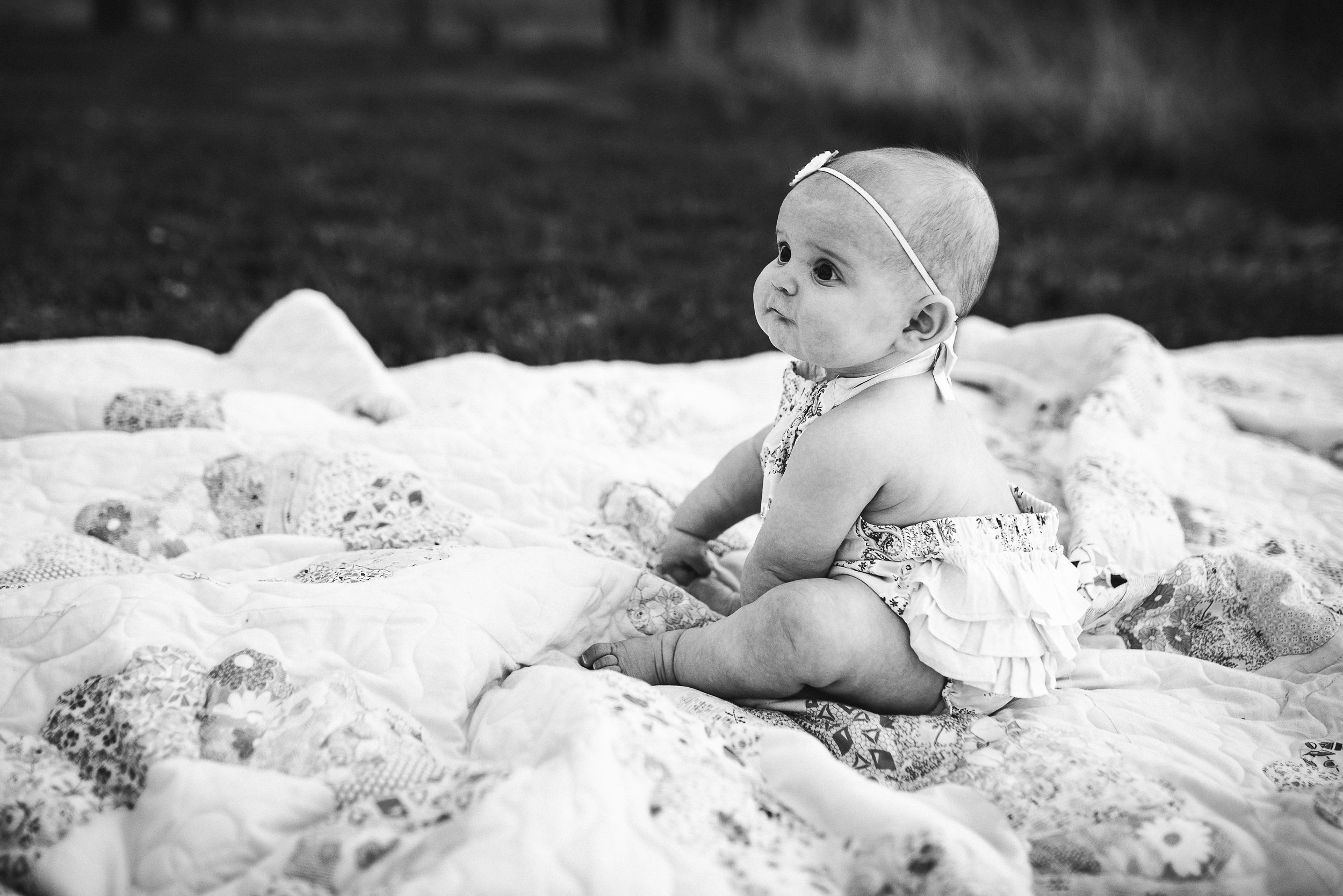 side view of baby girl in field