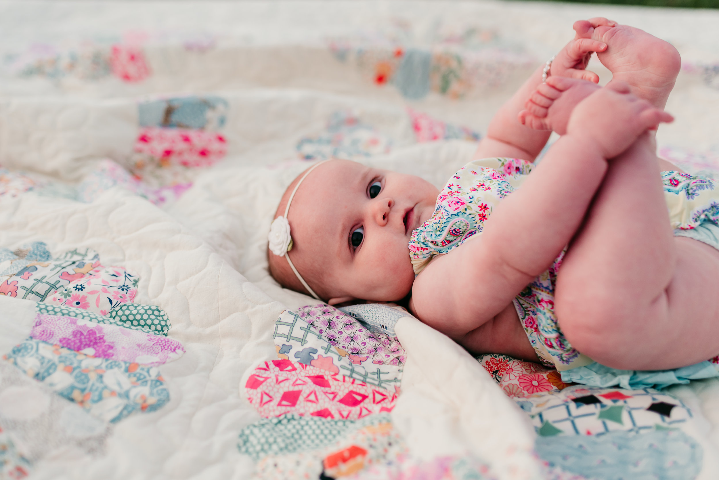 baby holding her feet St. Louis baby photographer