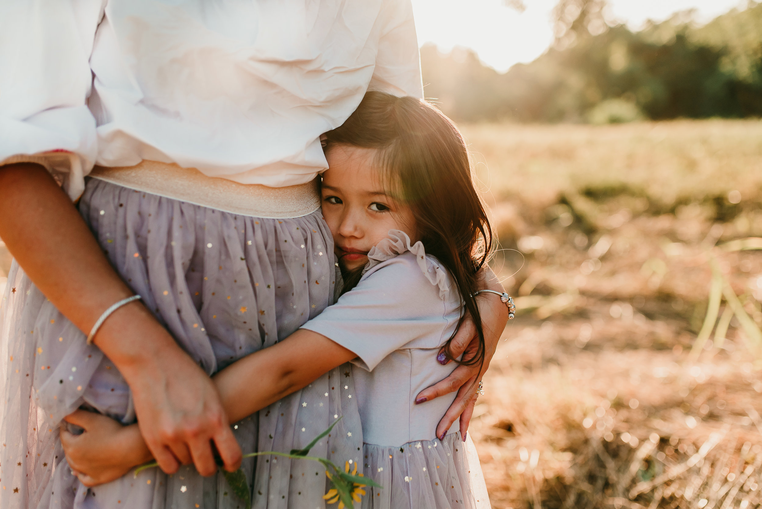 little girl holding her mom