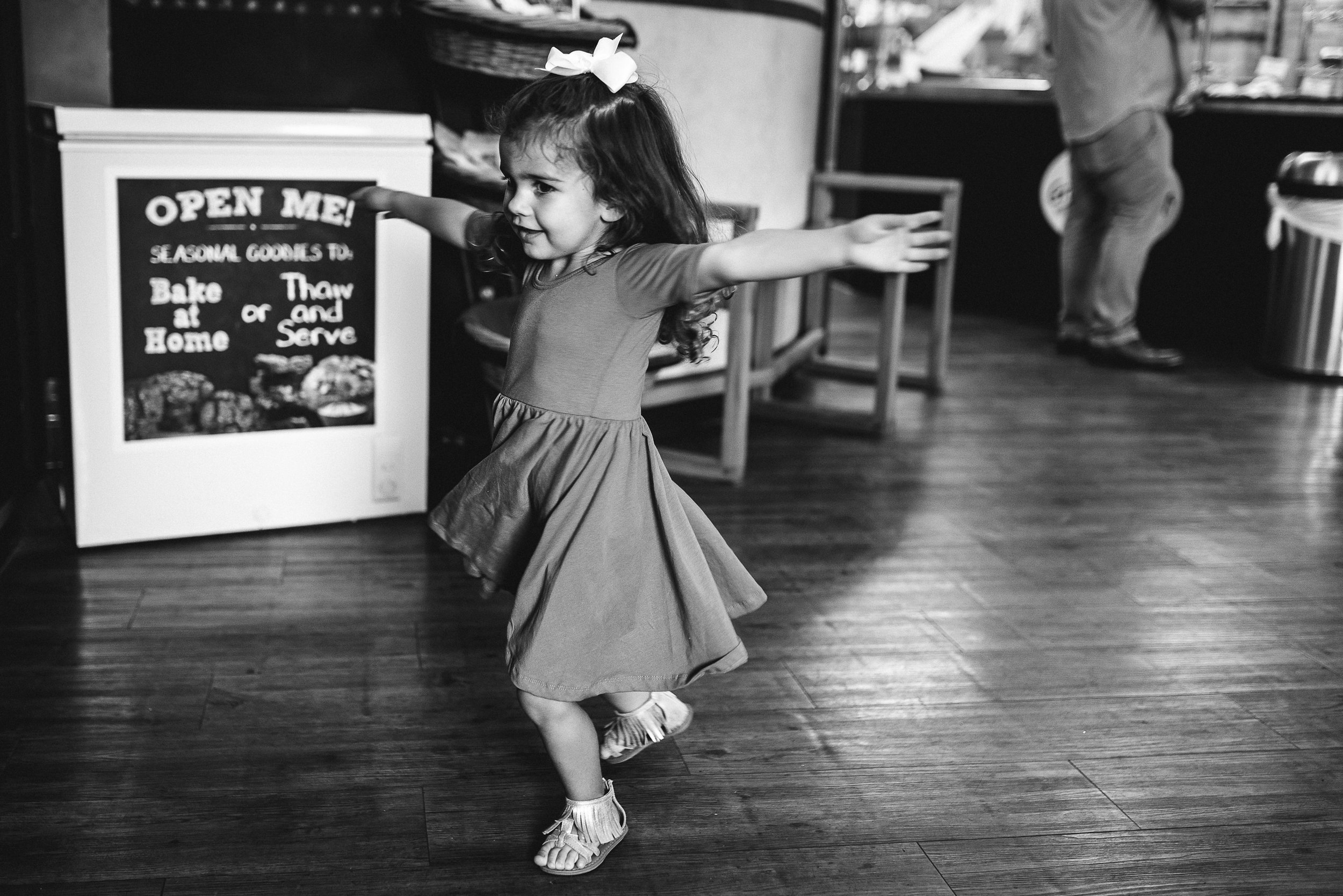 daughter twirling in bakery