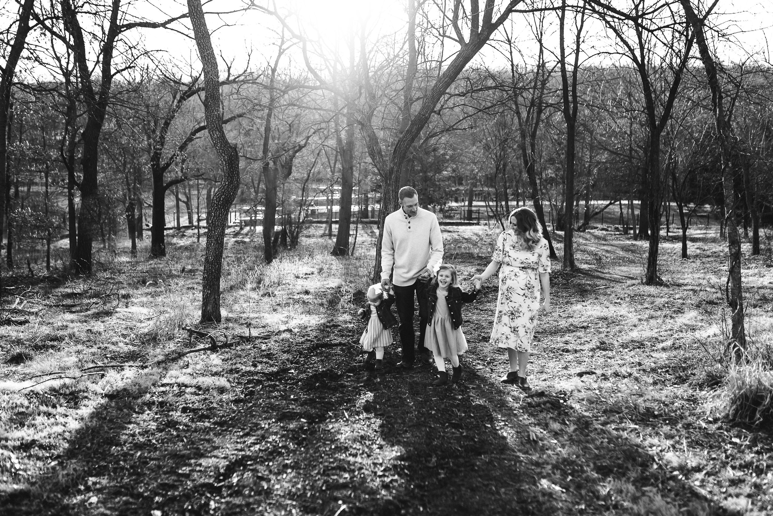 black and white image family walking