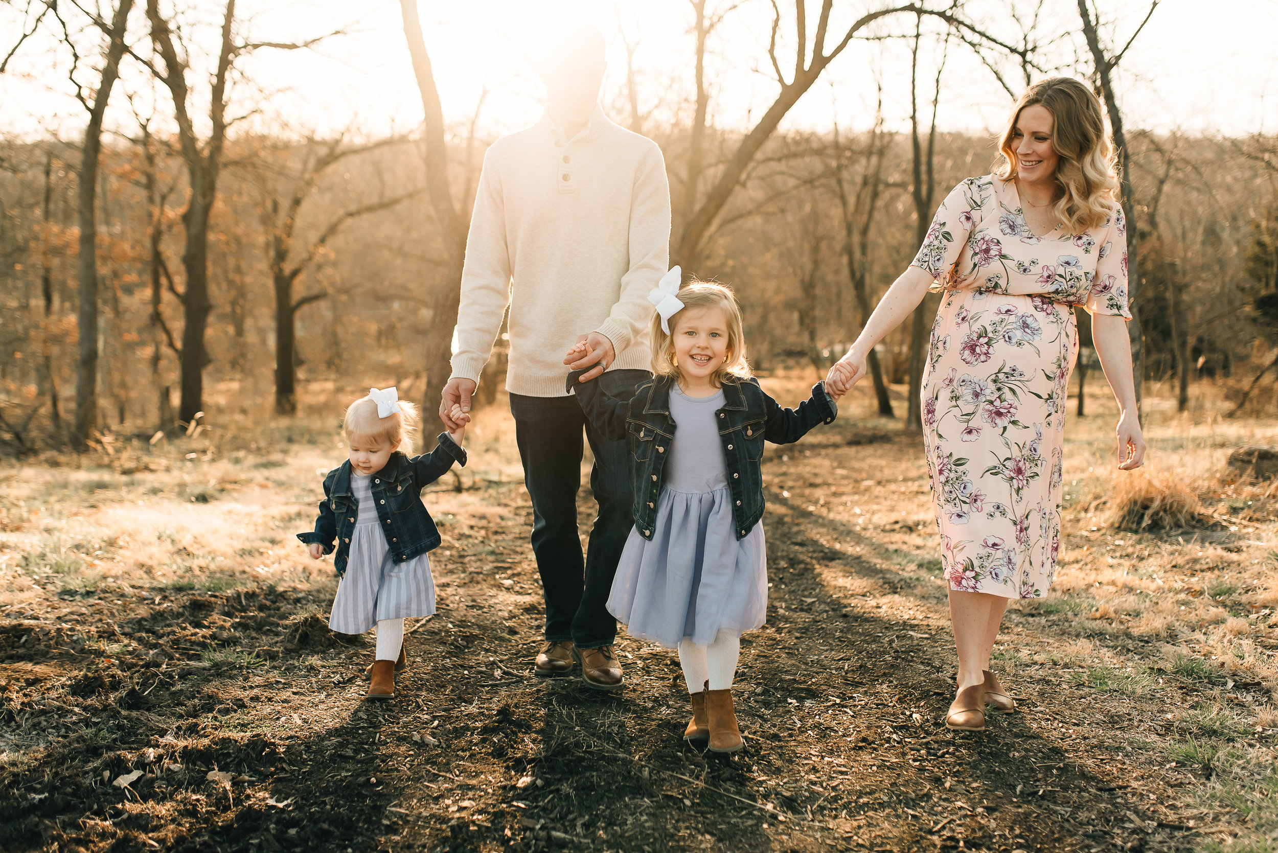 family holding hand and walking