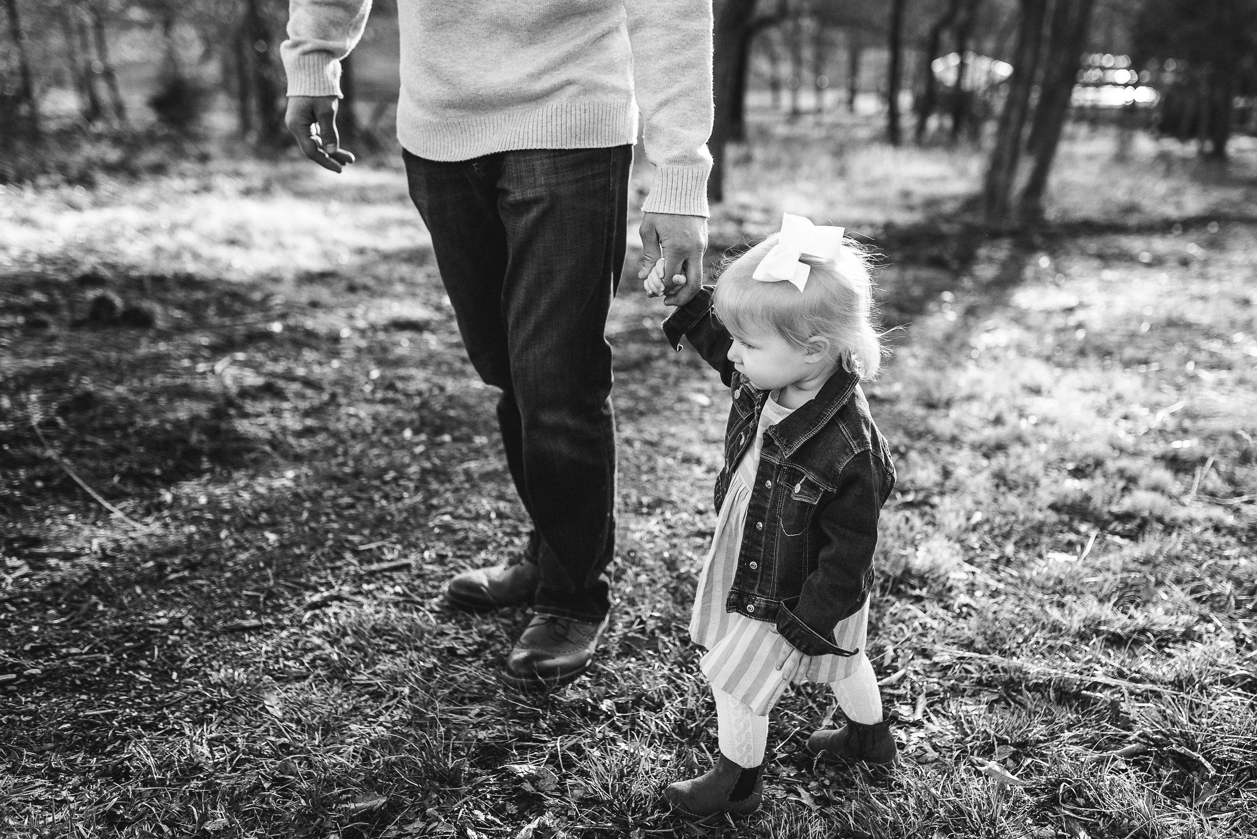 baby walking with dad