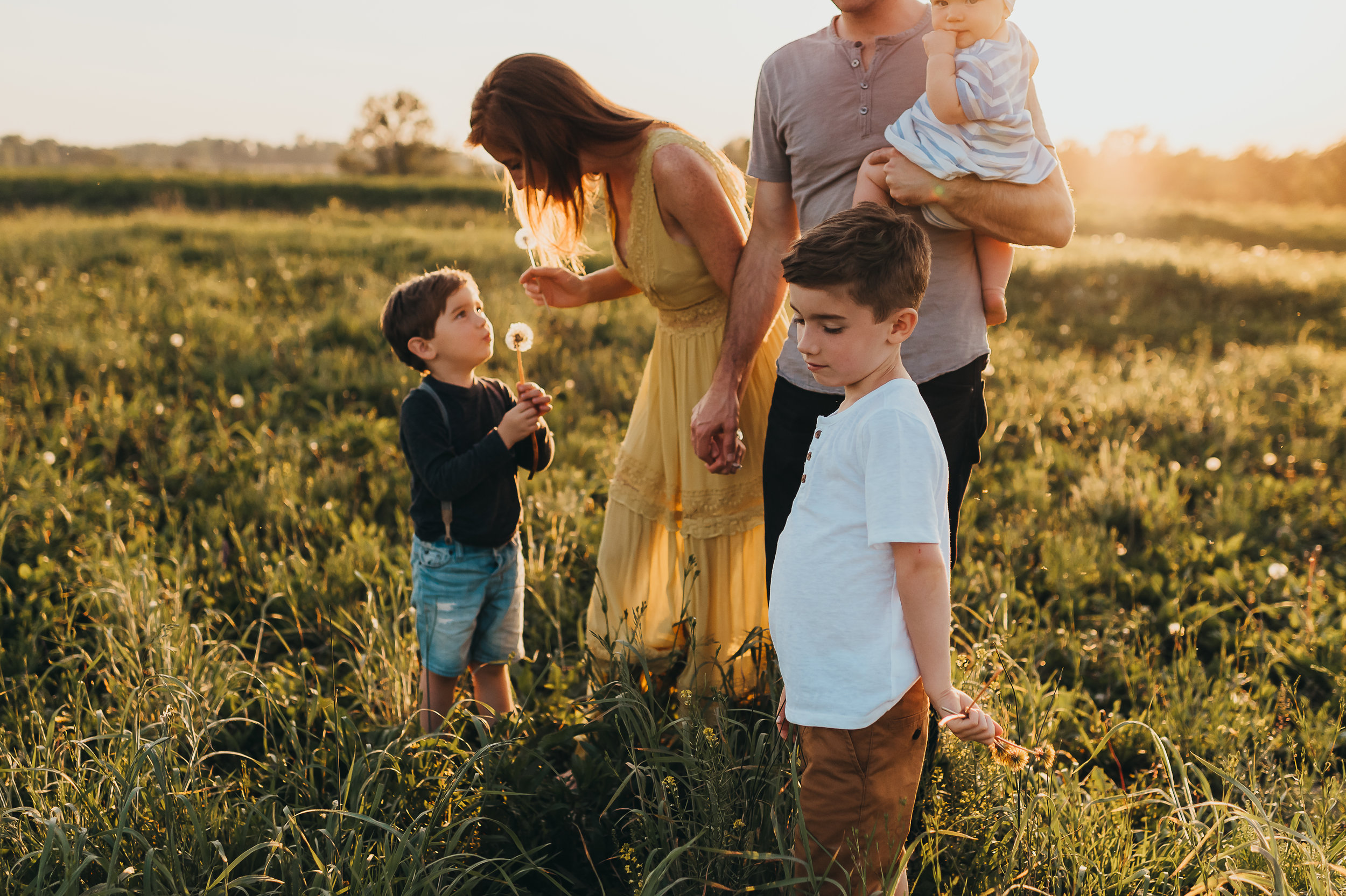 family in a flower field at sunset