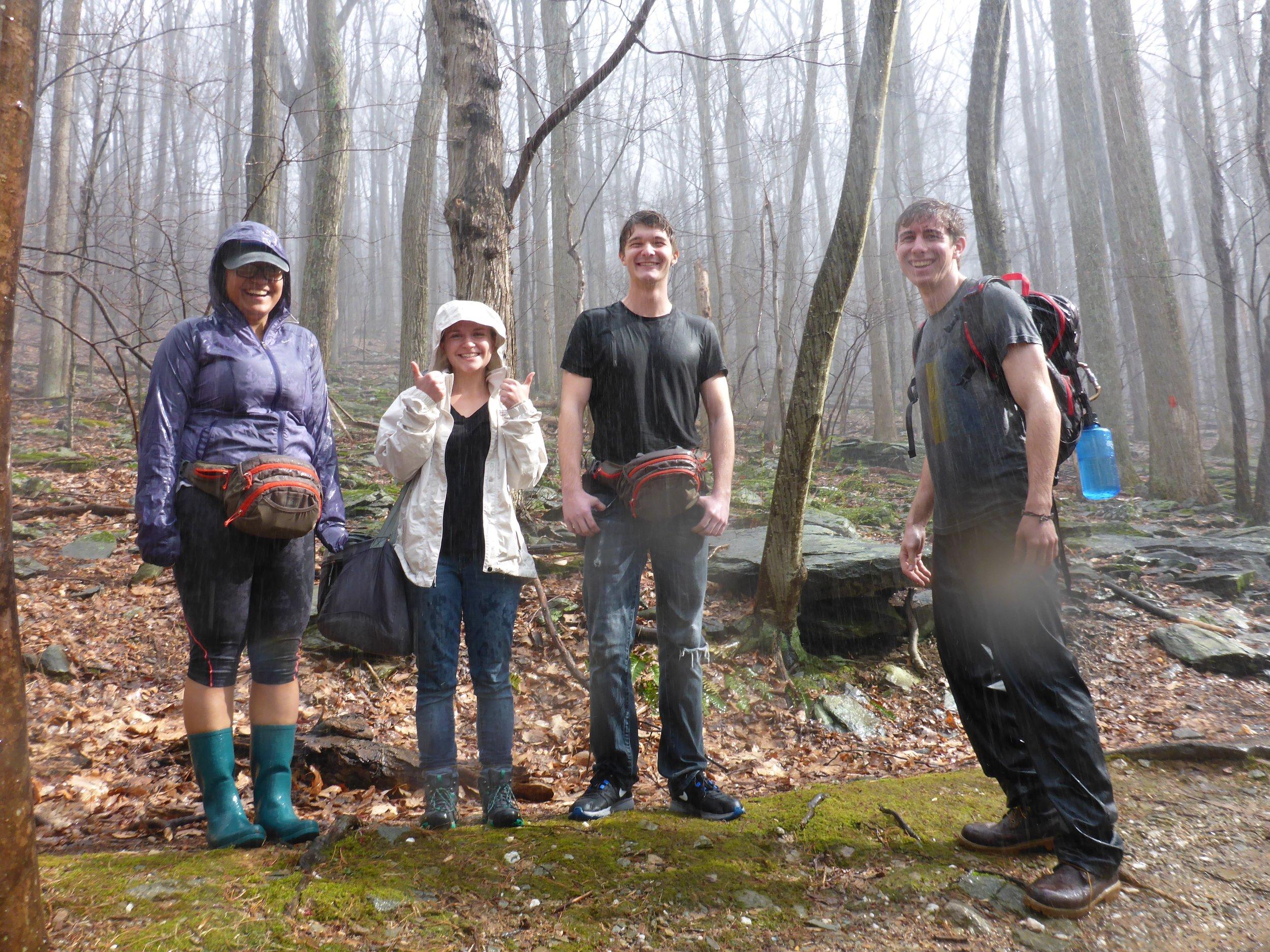 Melissa, Tori, Ben, and Matt stuck in the rain during salamander collection