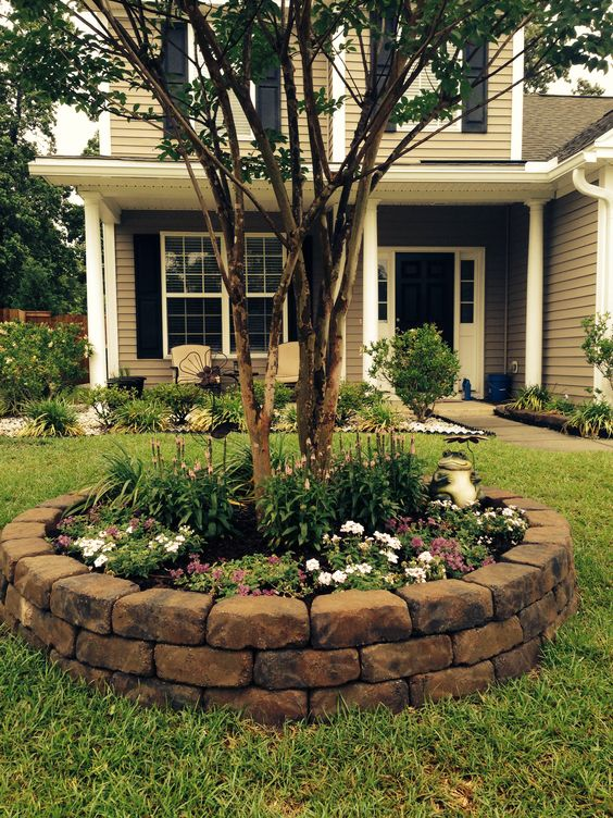 Rock Beds - Plant a plethora of your favorite floral colors surrounding the base of a tree and add this cool rock bed to make it look polished.