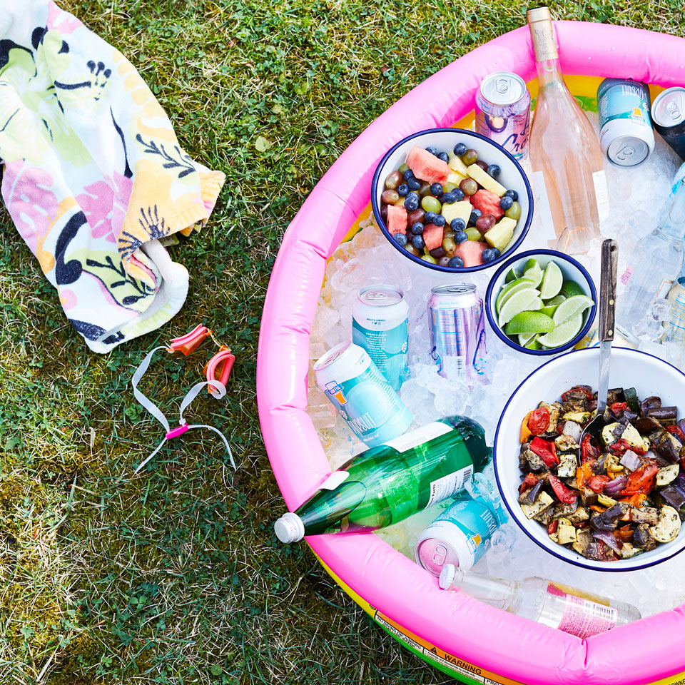Keep it Cool - Utilize your kid's pool for your cold items!
