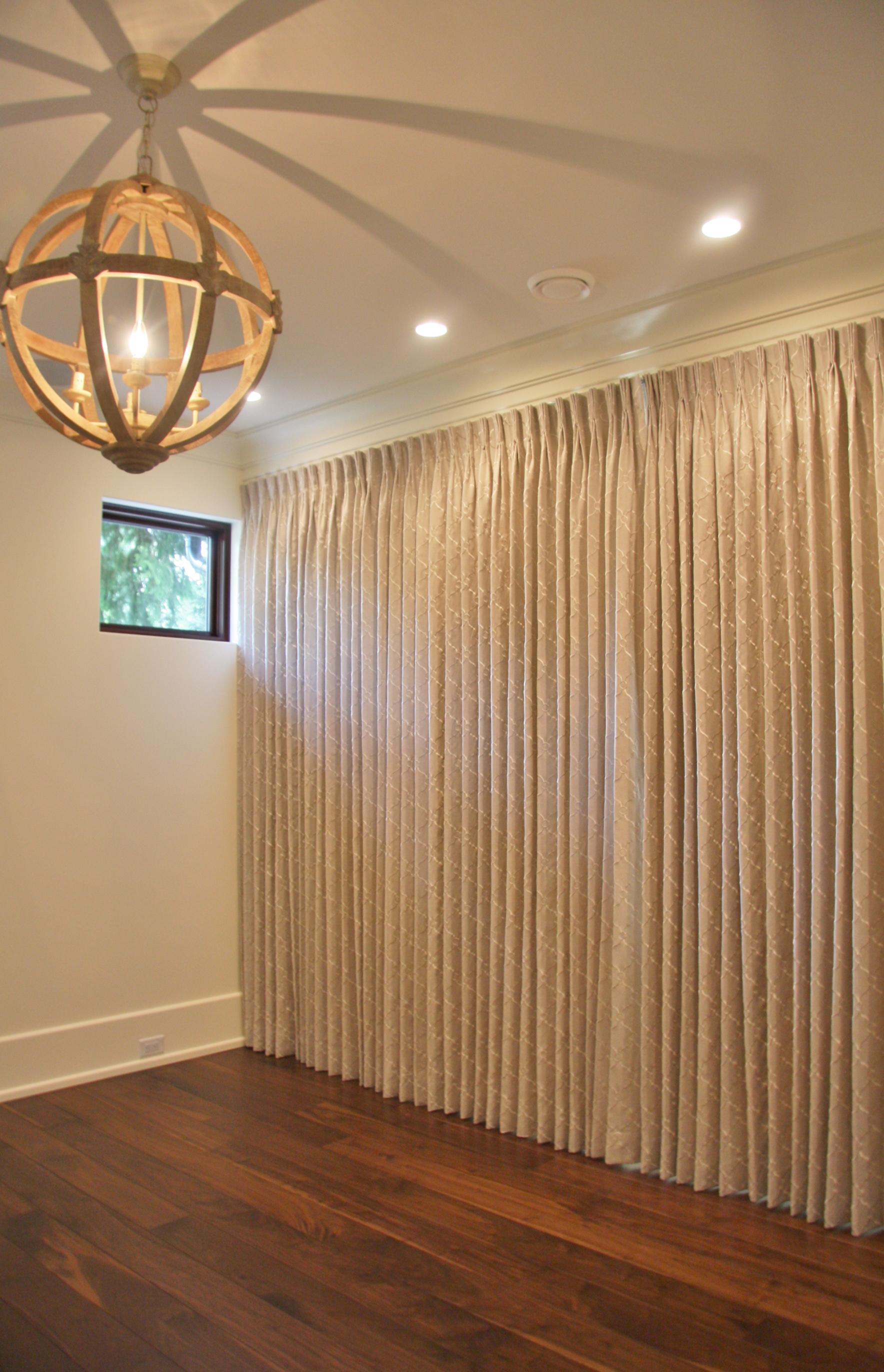 Wall to wall custom pinch pleat drapes