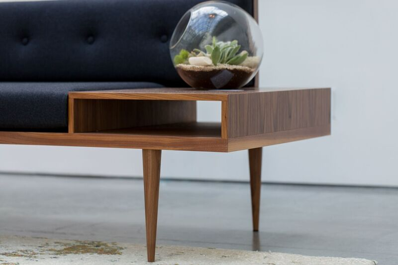 Bespoke Mid Century Modern inspired sofa, with walnut base and built in side-table.