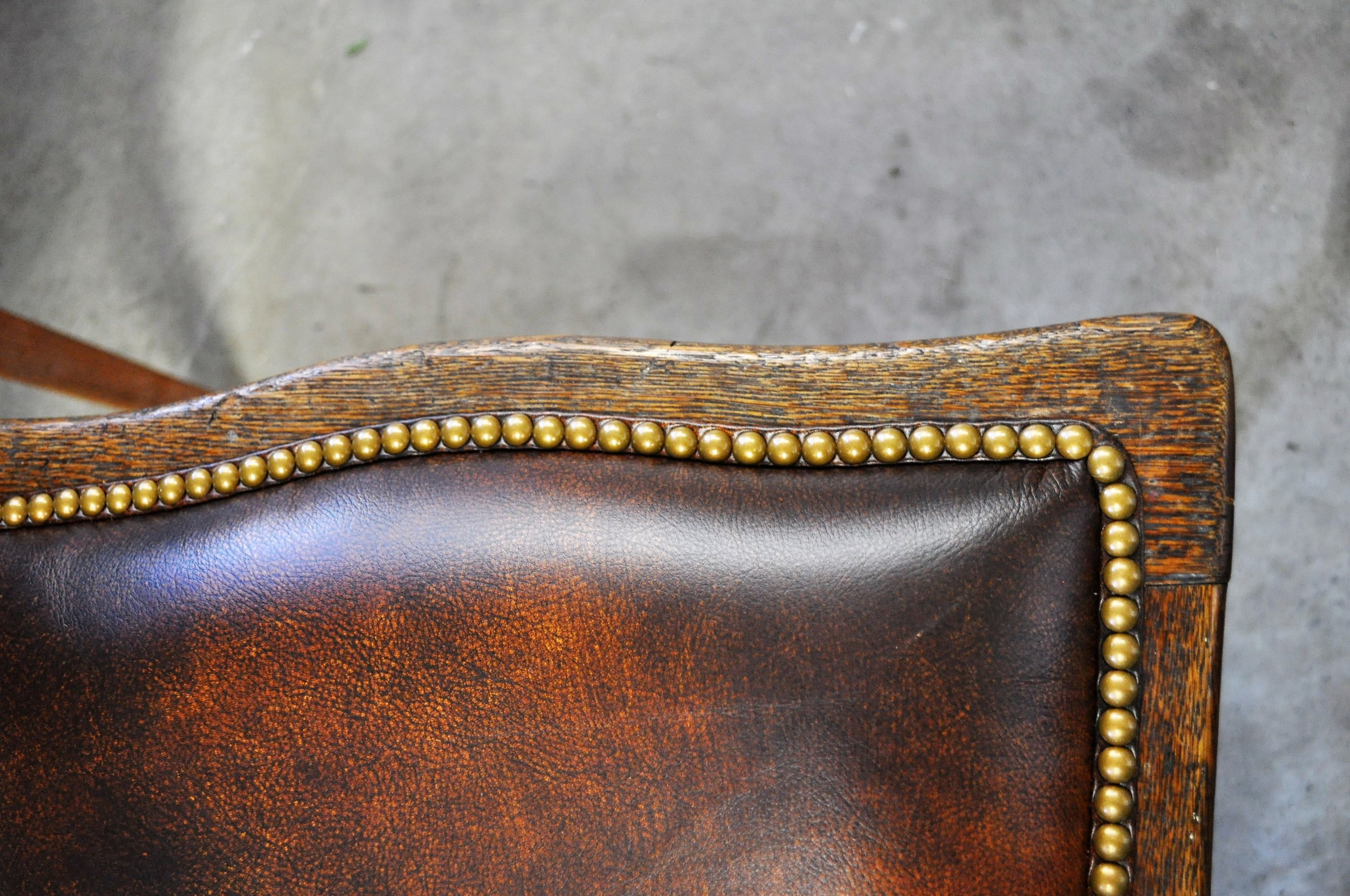 Stud detail on a restored antique rocker.