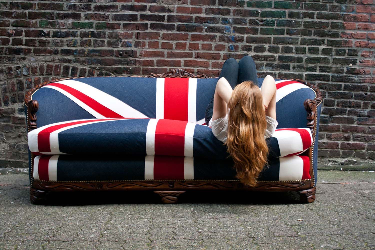 Creative antique sofa restoration. Union Jack flag sofa photo by Kara Joi in our beautiful and eclectic Gastown