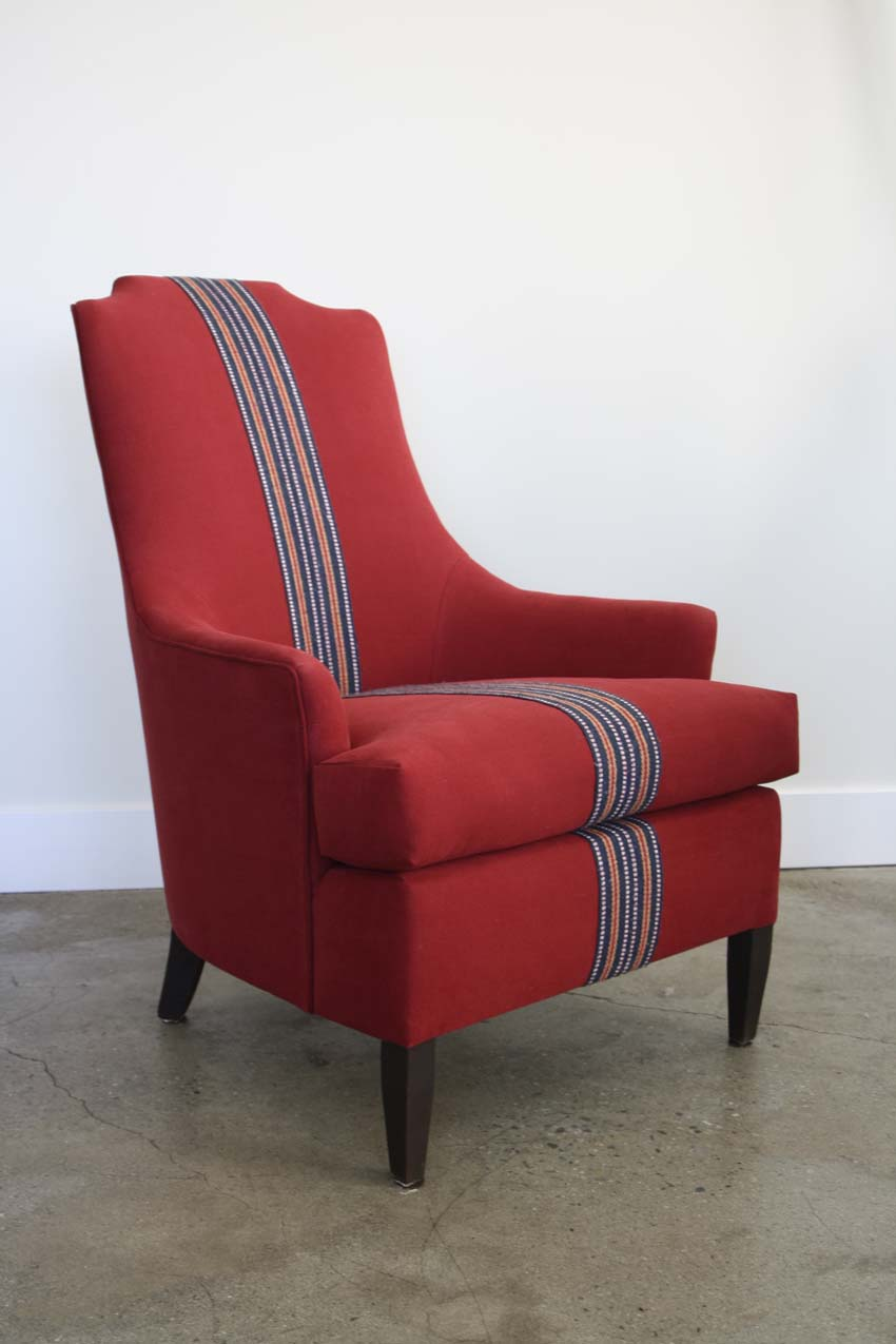Creative antique restoration. Upholstered in red brushed cotton fabric and vintage strapping