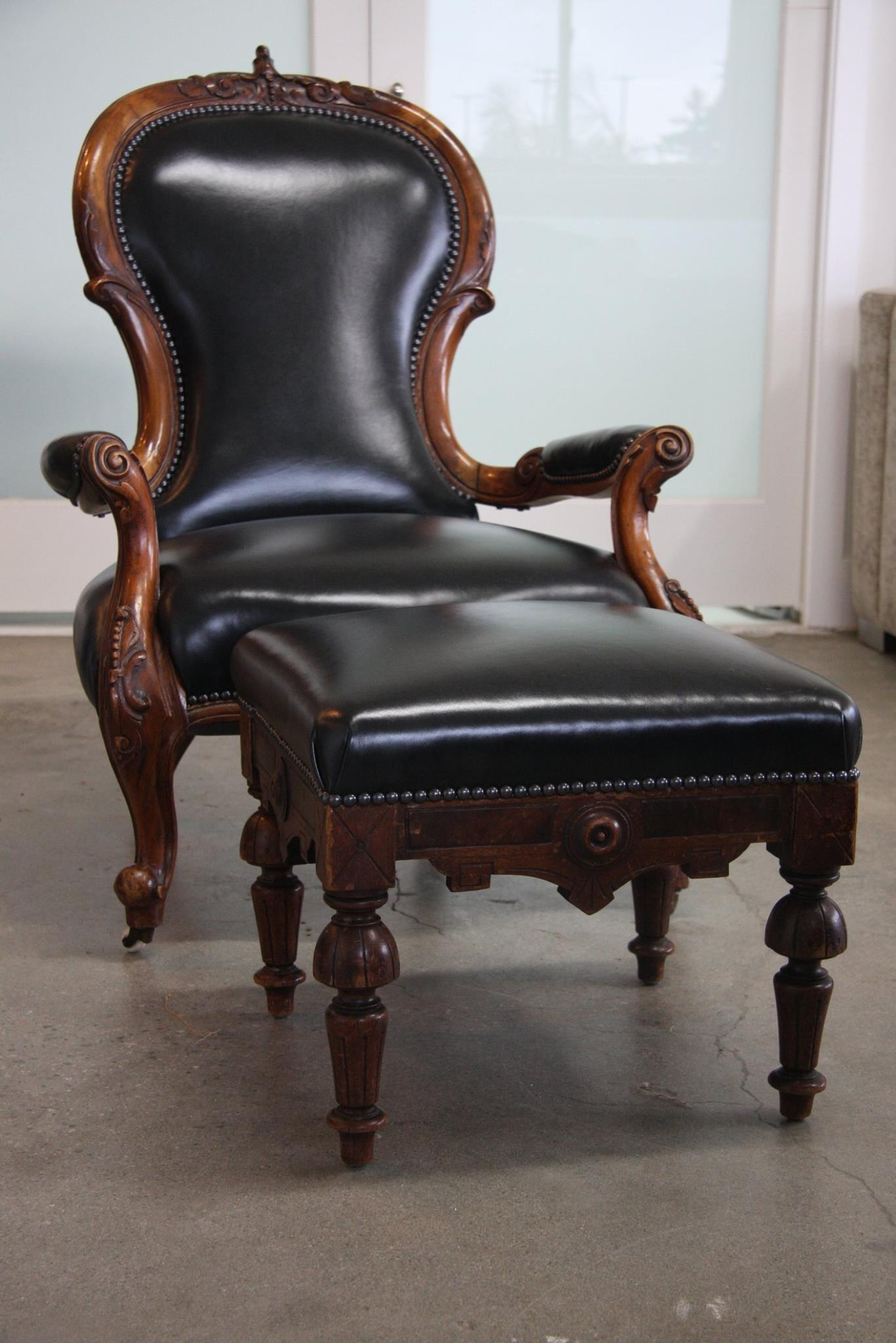 Newly upholstered Gentleman's Chair in bi-cast leather with stud trim.