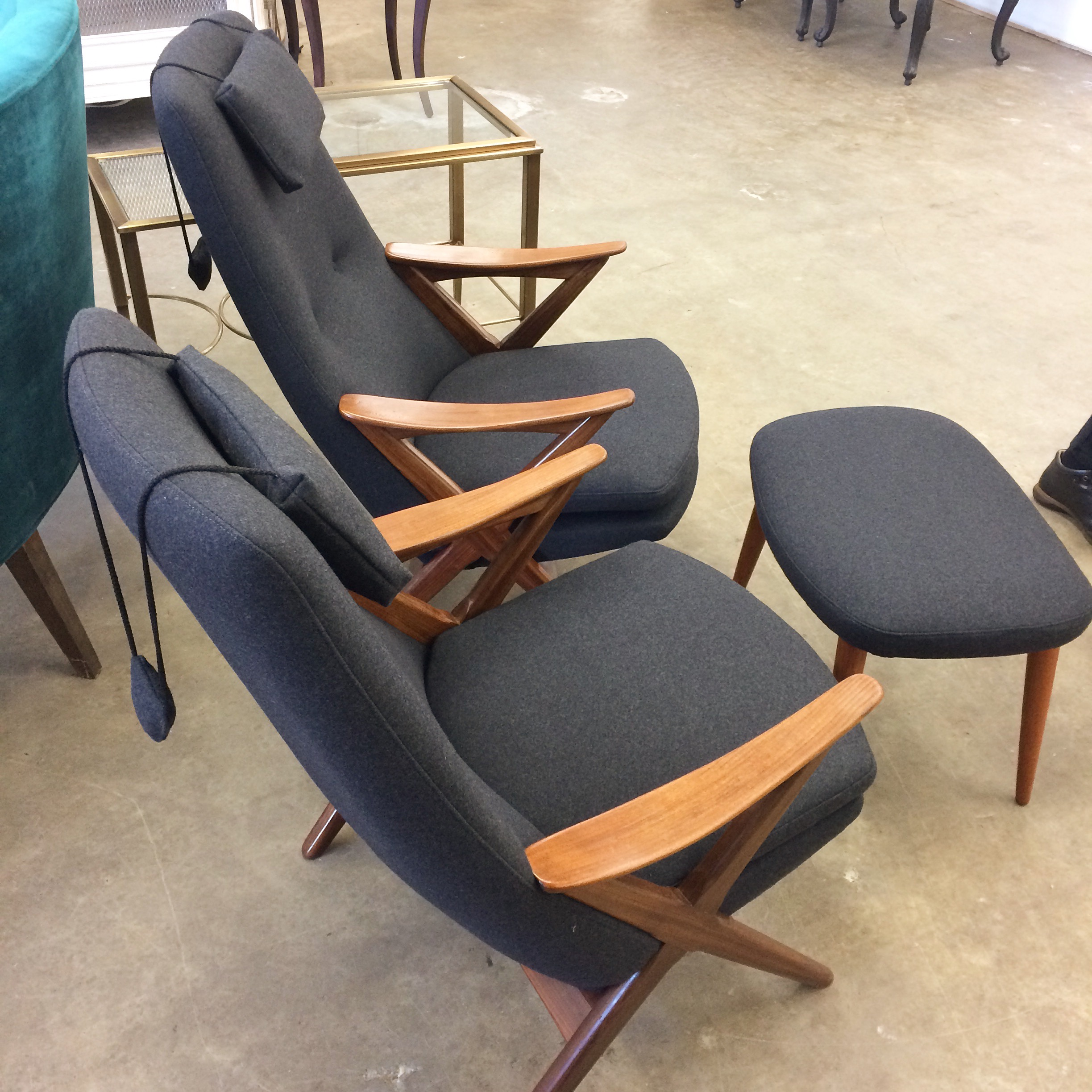 Mid Century Modern teak arm chairs, with button tufting and weighted headrests.