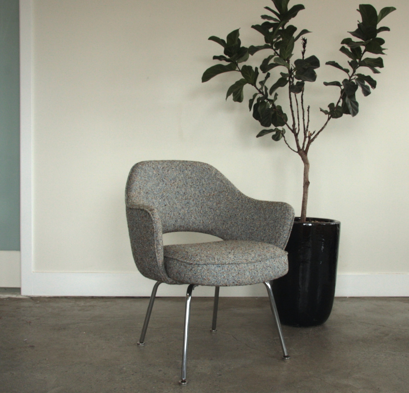 Mid Century Modern chair, upholstered in grey wool and piping trim.