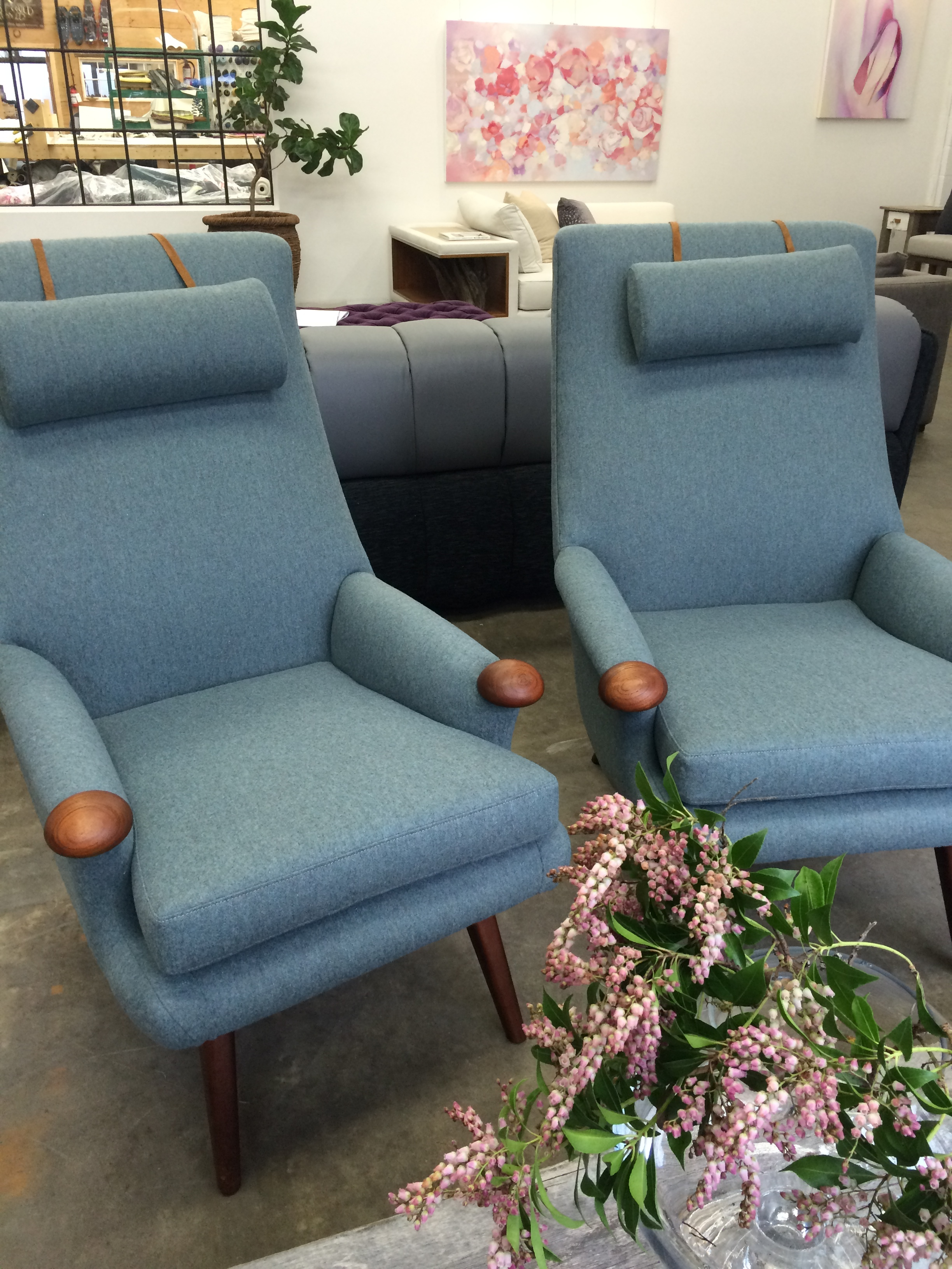 Restored Helmut Krutz armchairs with teak accents, and weighted headrests.