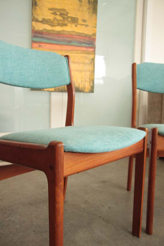 Mid Century Modern teak dining chairs with piping trim.