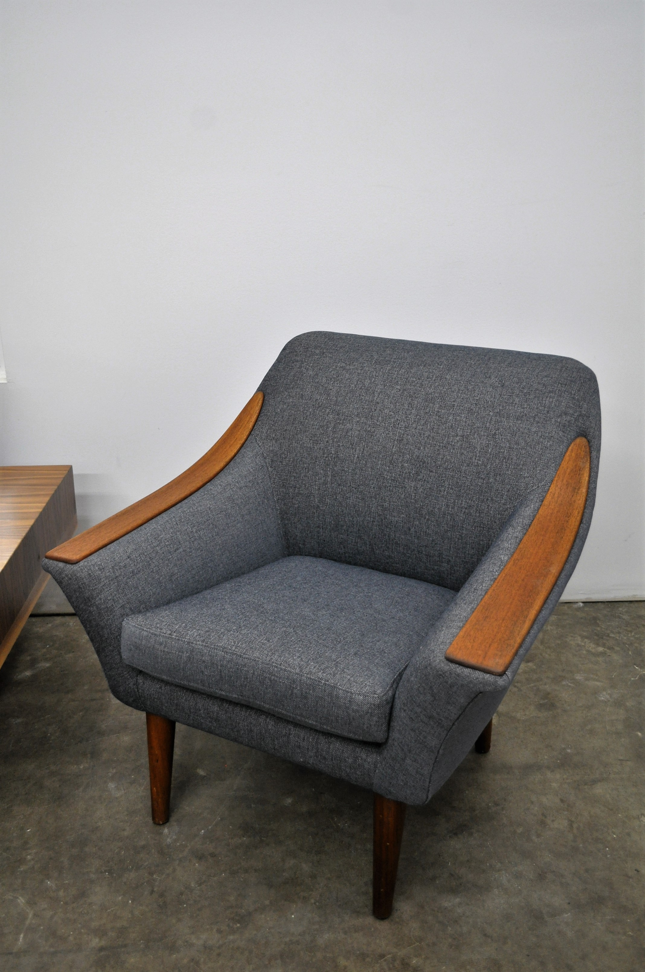 Mid Century Modern restored armchair, with wood panel arms and topstitch detail.
