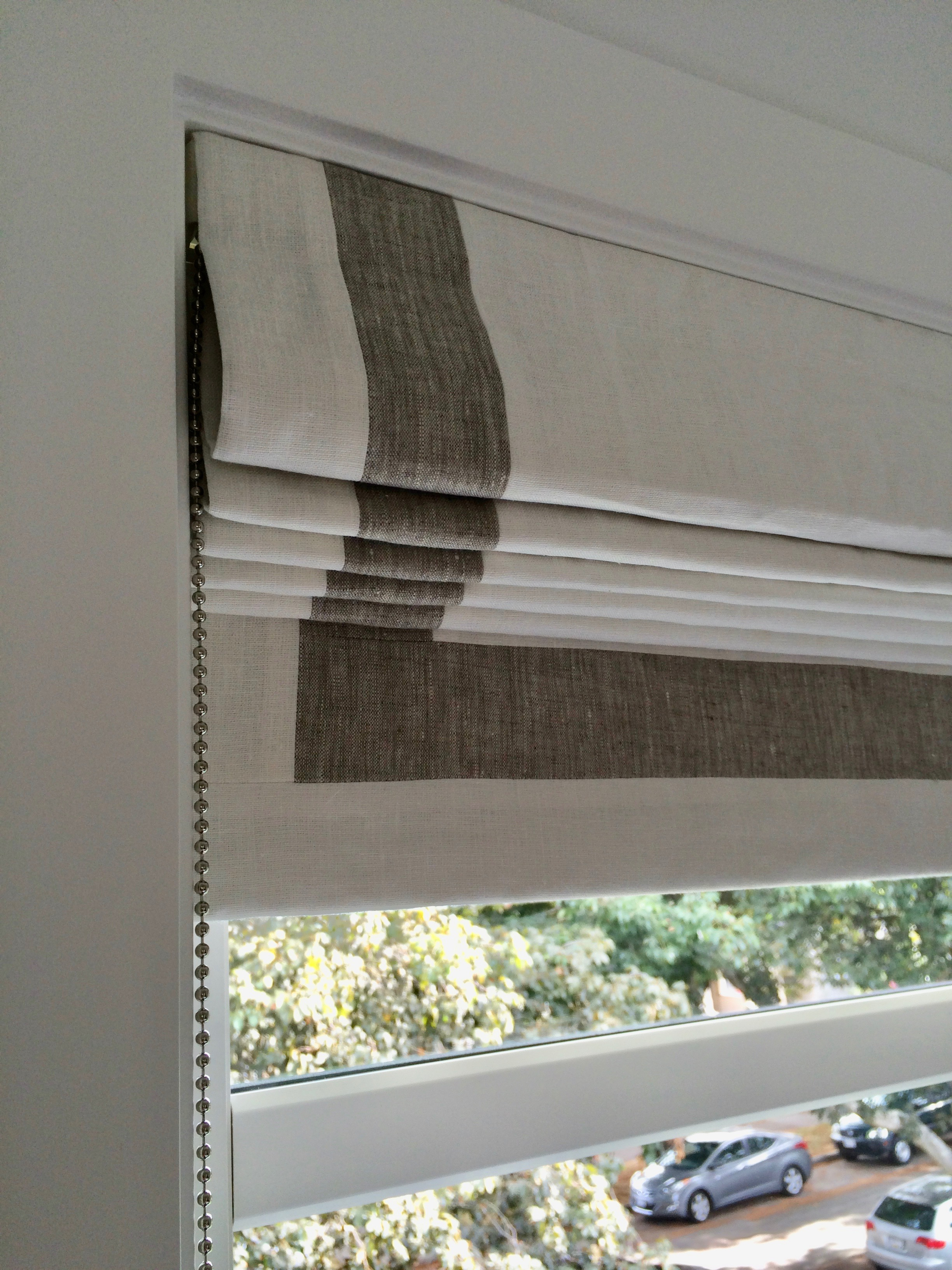 Banded back tab Roman Shade in linen