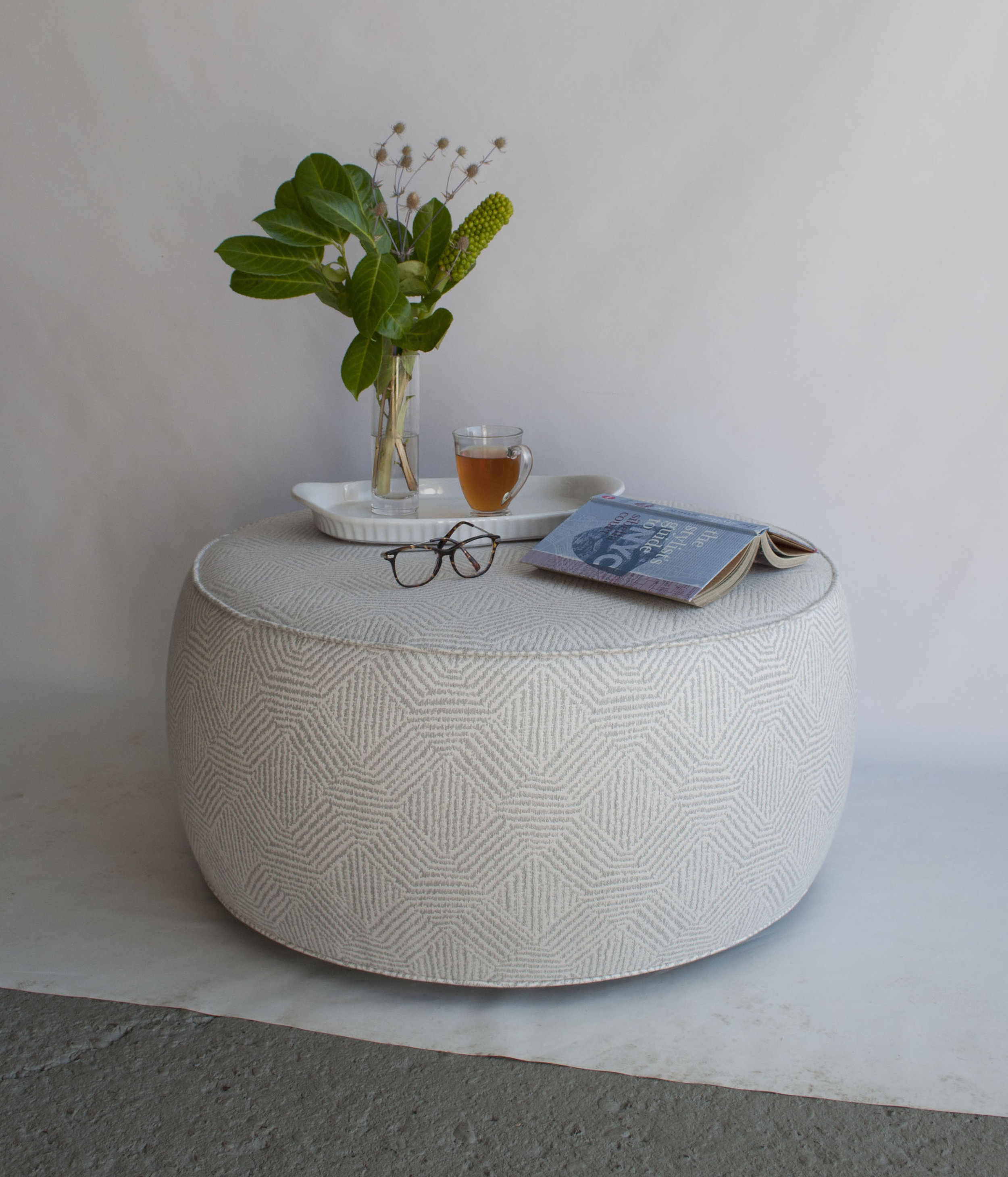 Bespoke round ottoman with piping trim designed by Amanda Evans Interiors