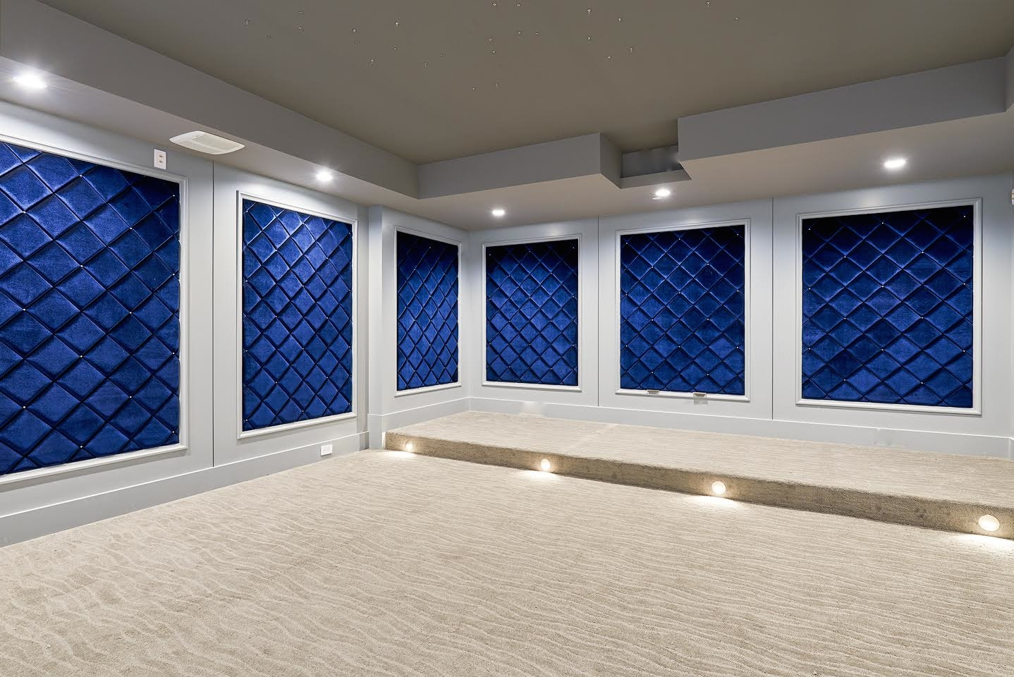 Upholstered diamond wall panels for a home theater.