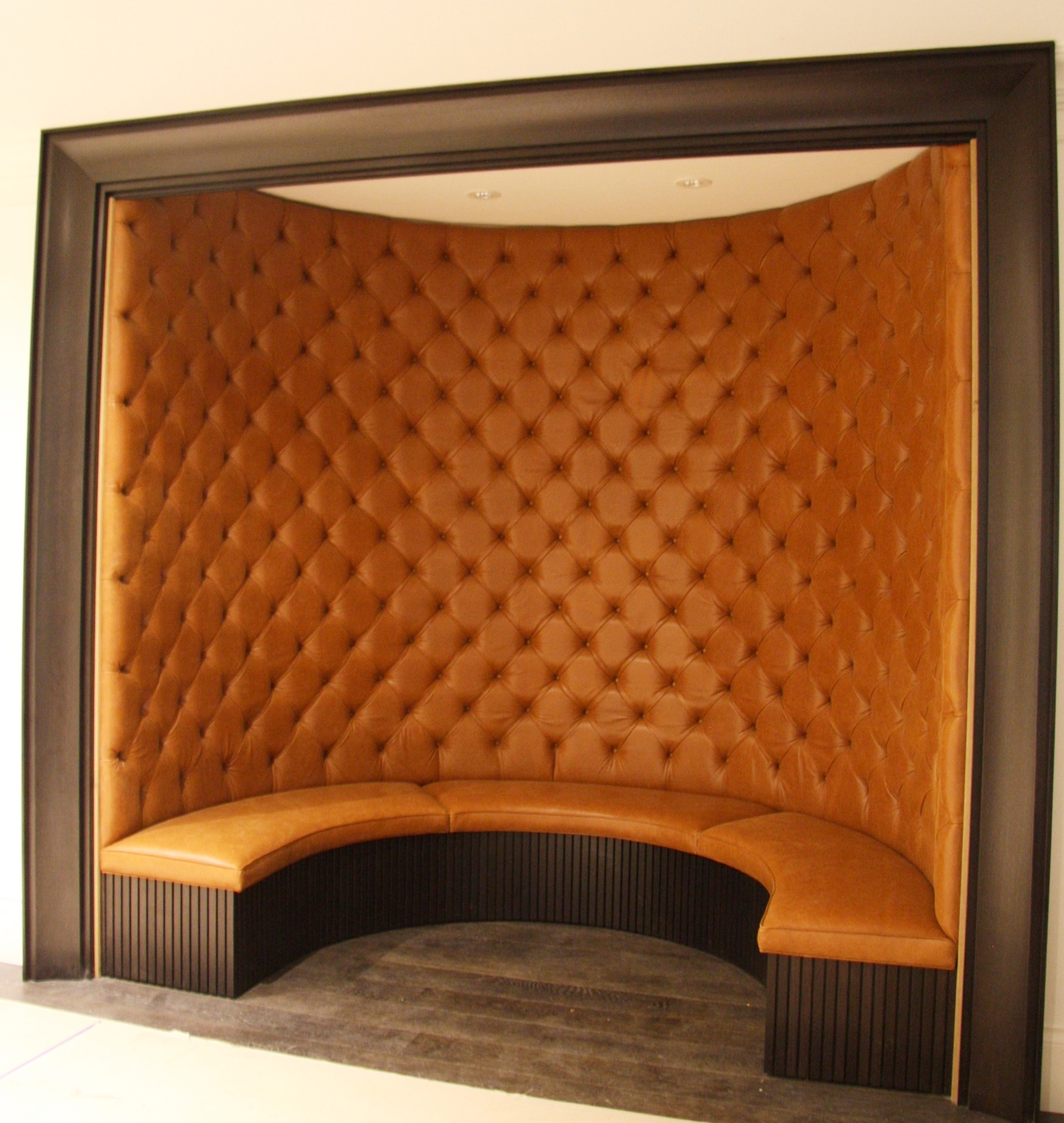 Built in curved booth seating Designed by Kelly Deck design
