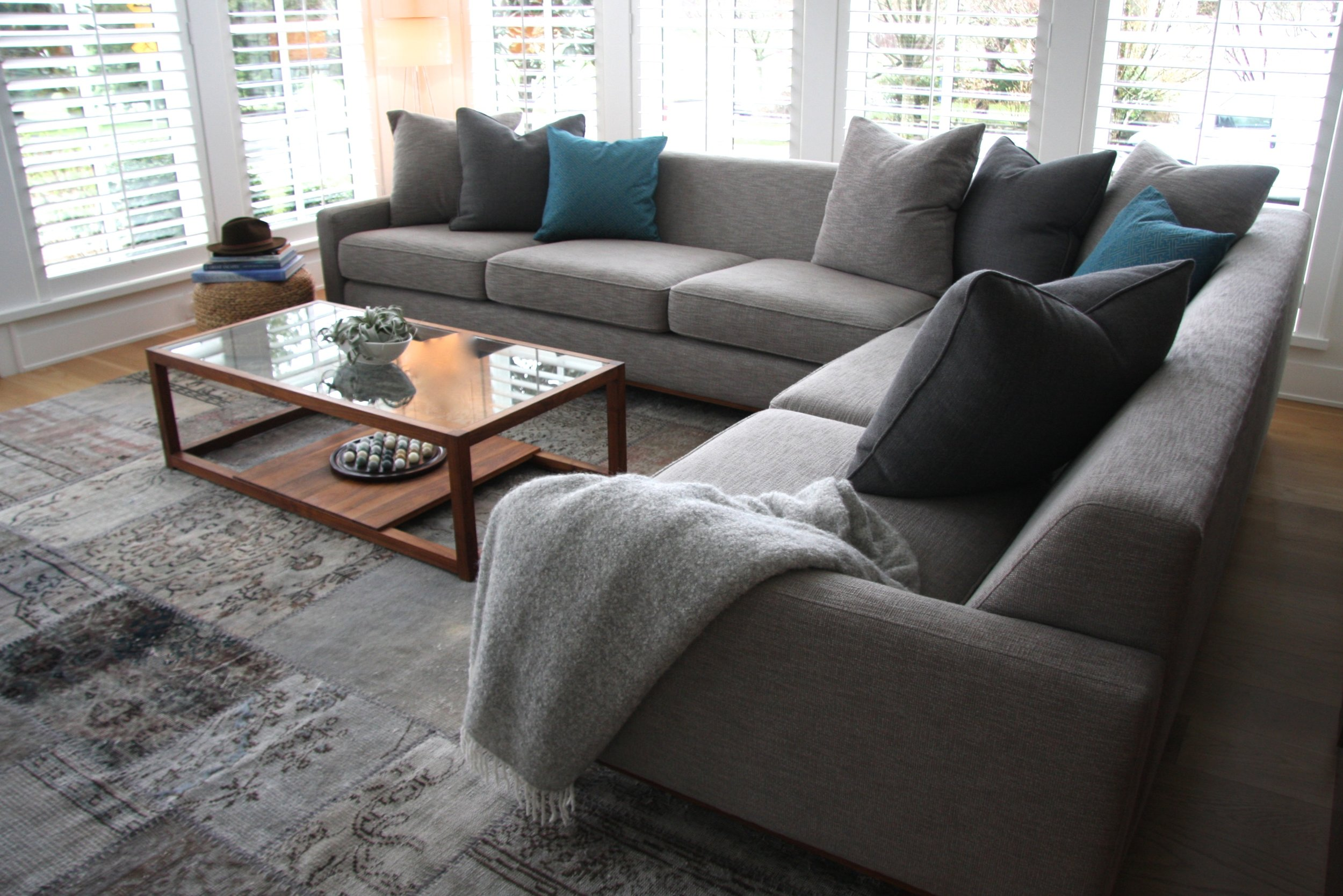 Bespoke sectional sofa with a mix of comfy toss pillows designed by Zacharko Yustin Architects.