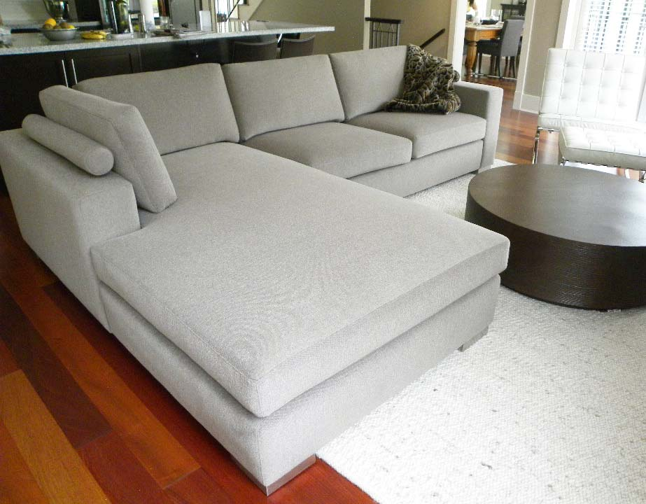 Bespoke sectional with bolster cushion supports, and chaise.