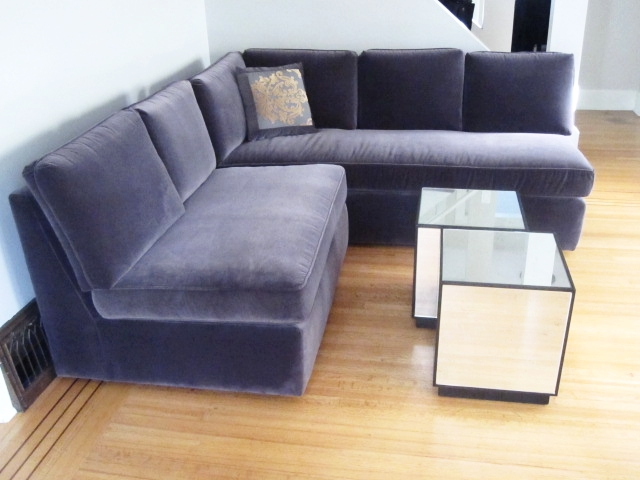 midnight velvet custom sectional sofa with feather back pillows and latex foam seat cushions. Designed by Balance Living design