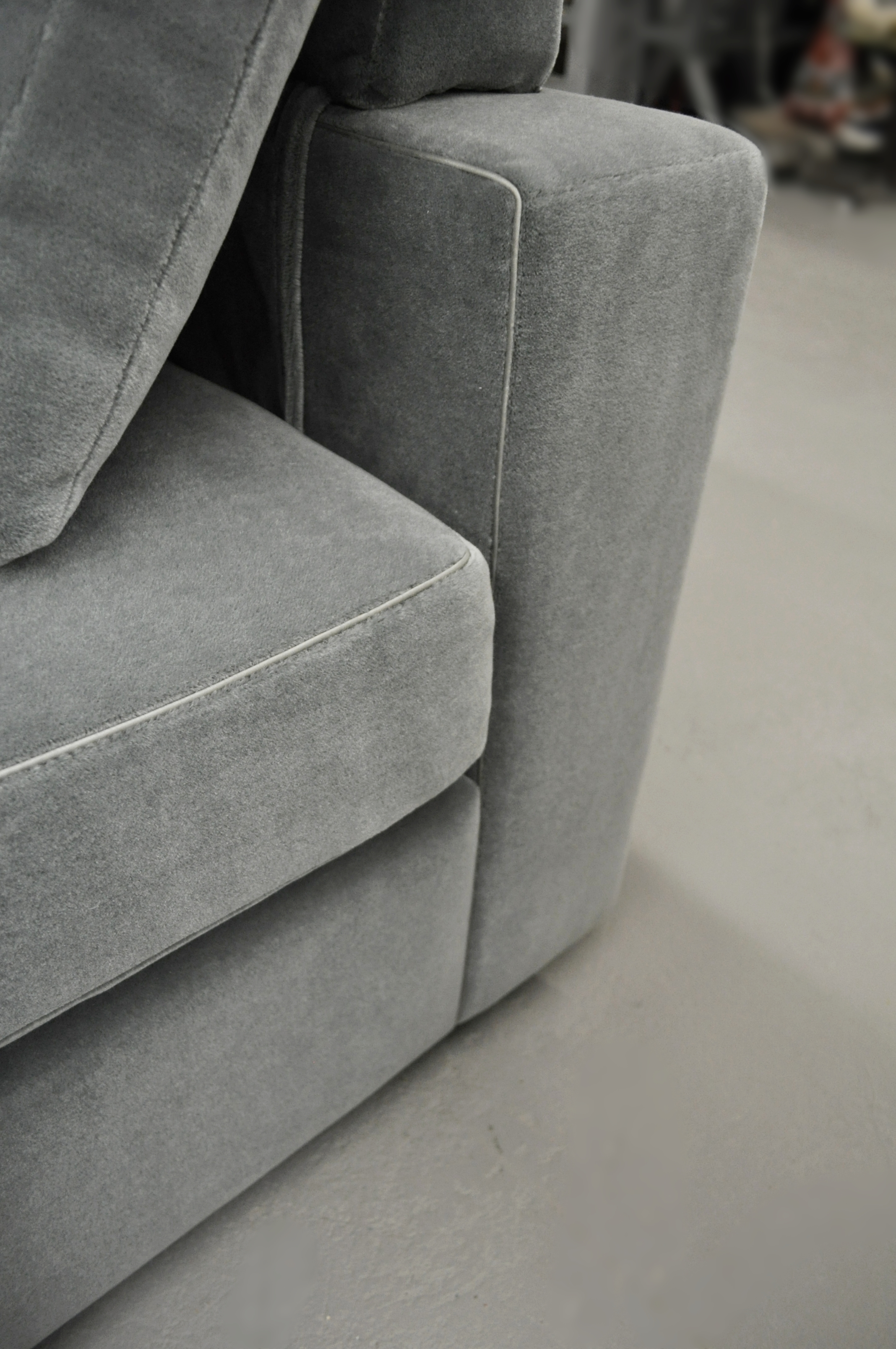 Detail shot of Livable Luxury sofa designed by Zacharko Yustin Architects. Mohair fabric with silk piping trim.