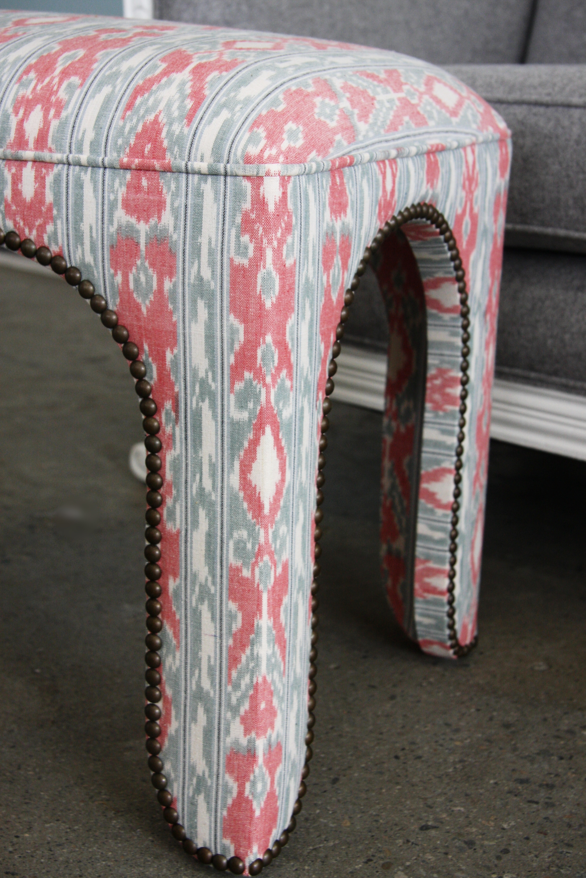 Moroccan inspired bench ottoman with studded trim.