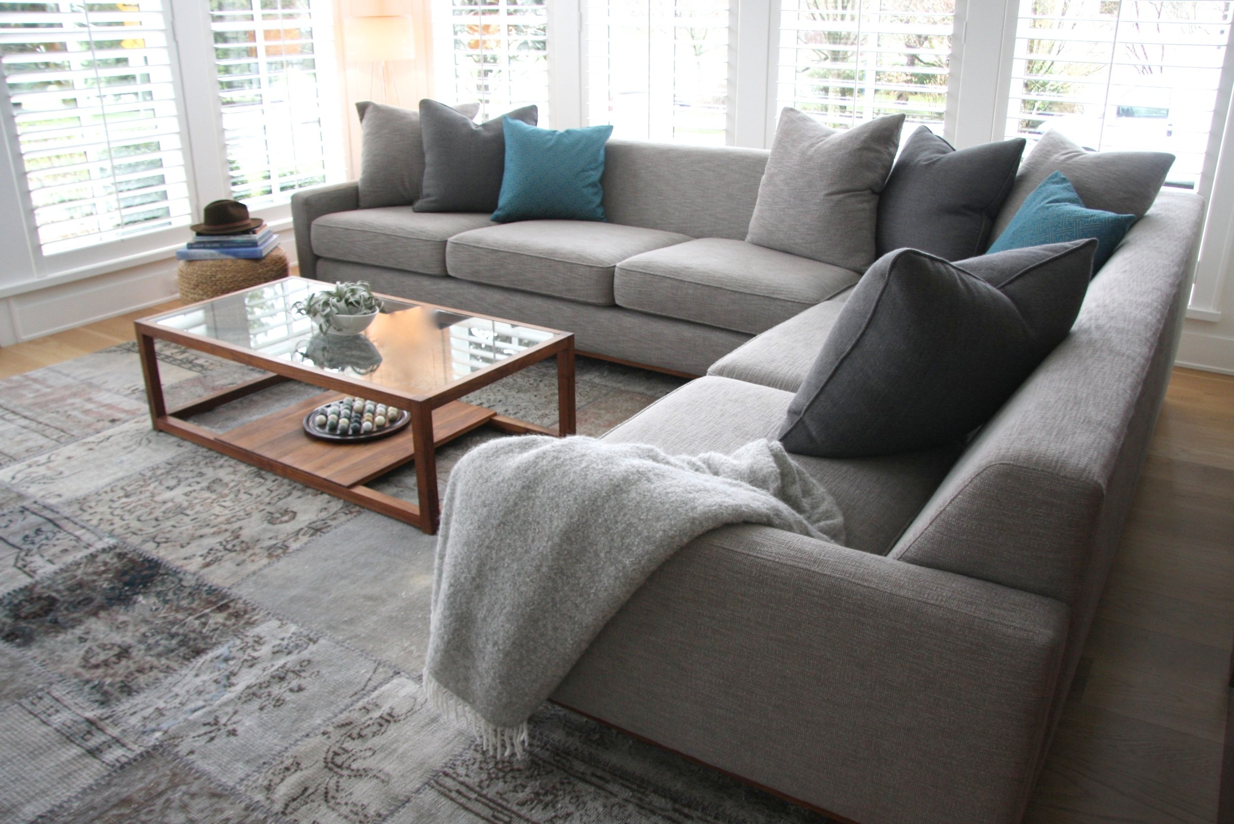 Bespoke sectional sofa with a mix of comfy toss pillows.