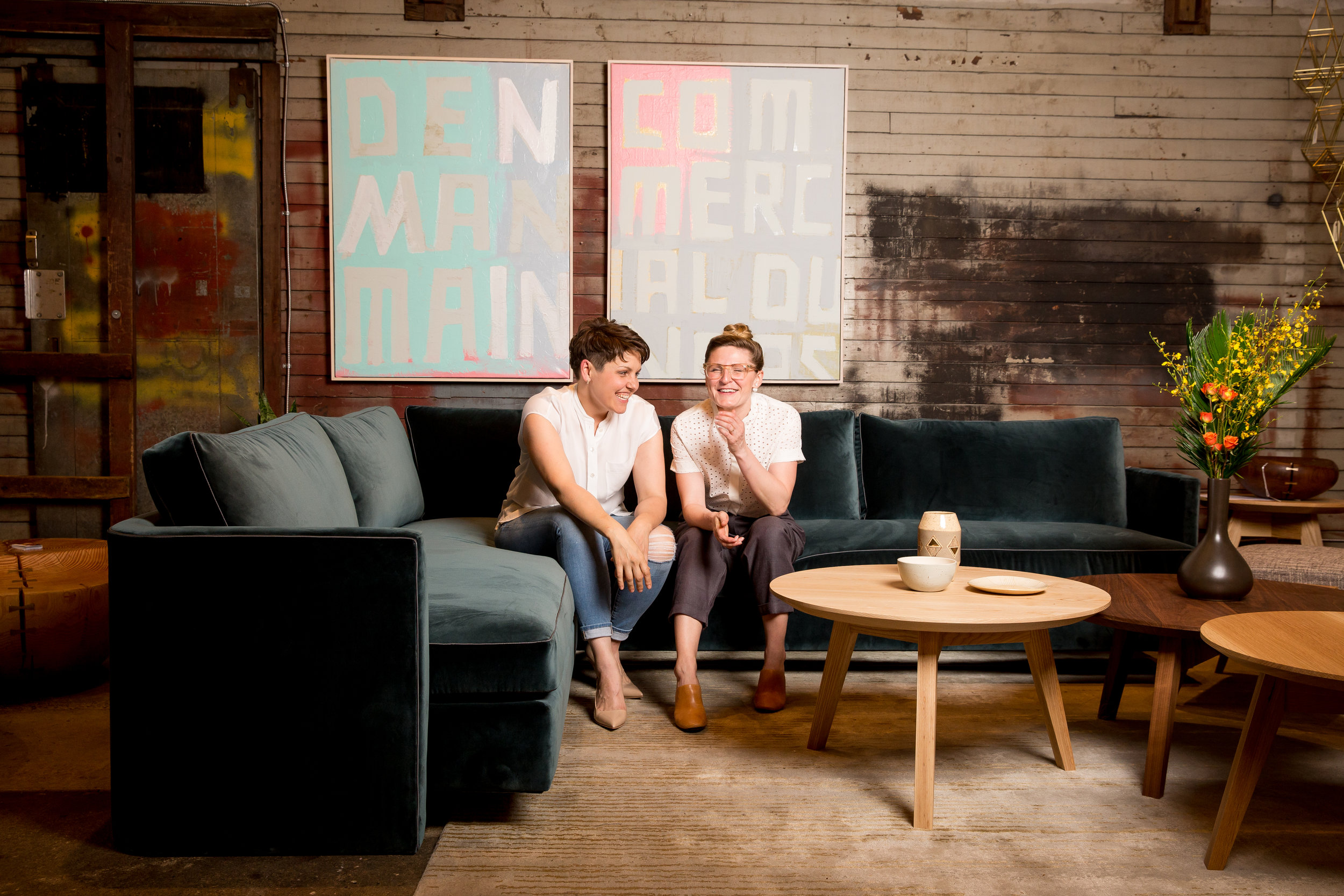 Kate Duncan and Amber Kingsnorth relax on the Livable Luxury sofa at Address Assembly, 2017. Image from Bright Photo.