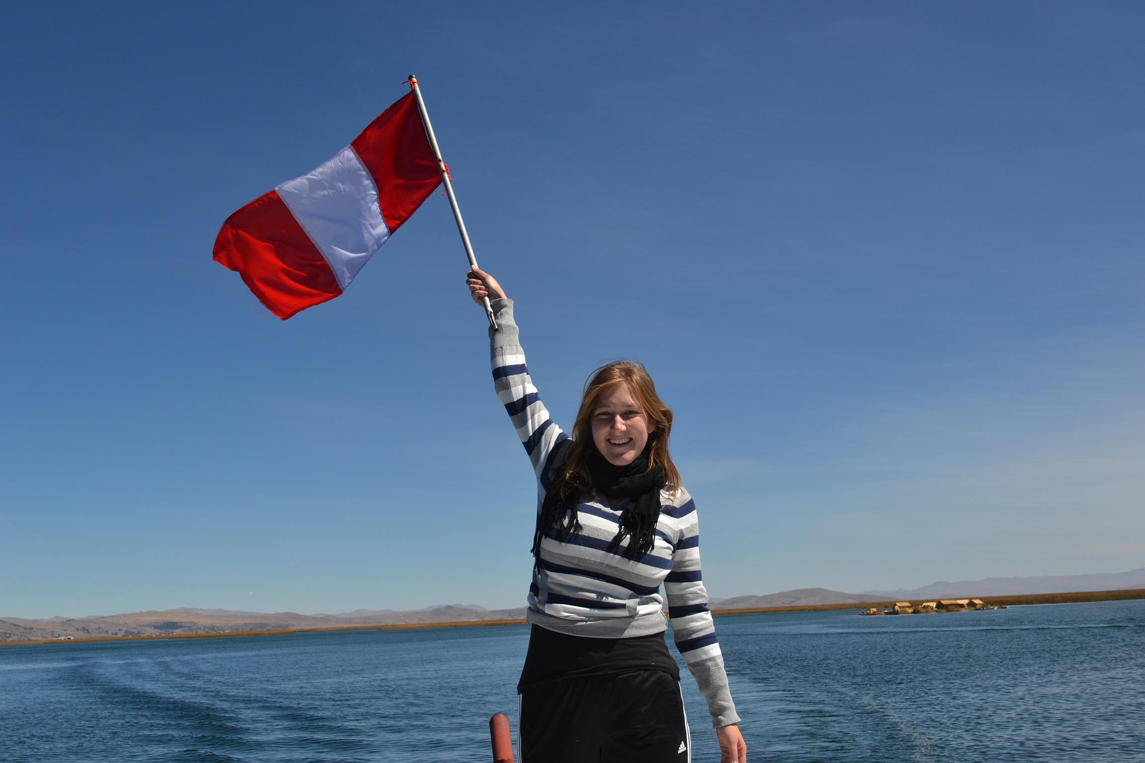 Holding Peruvian Culture up high ;) In the background: Lake Titicaca