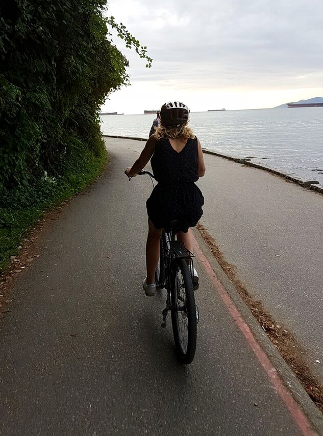 Riding a bike along the seawall of Stanley Park
