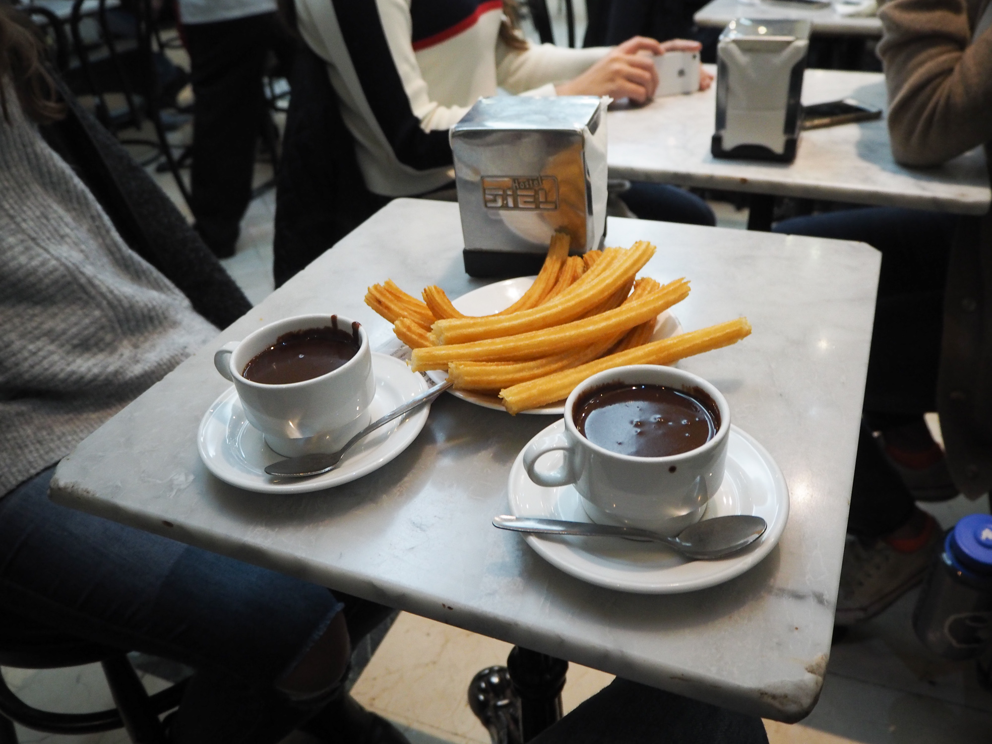 Churros at the Chocolatería San Gines: Don't drink the super rich chocolate. Just dip the churros. One portion of 6 churros and one chocolate (4 Euros)are enough for two