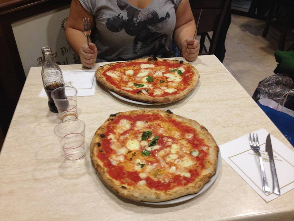 Me and a friend about to enjoy some delicious margherita pizza in Naples.