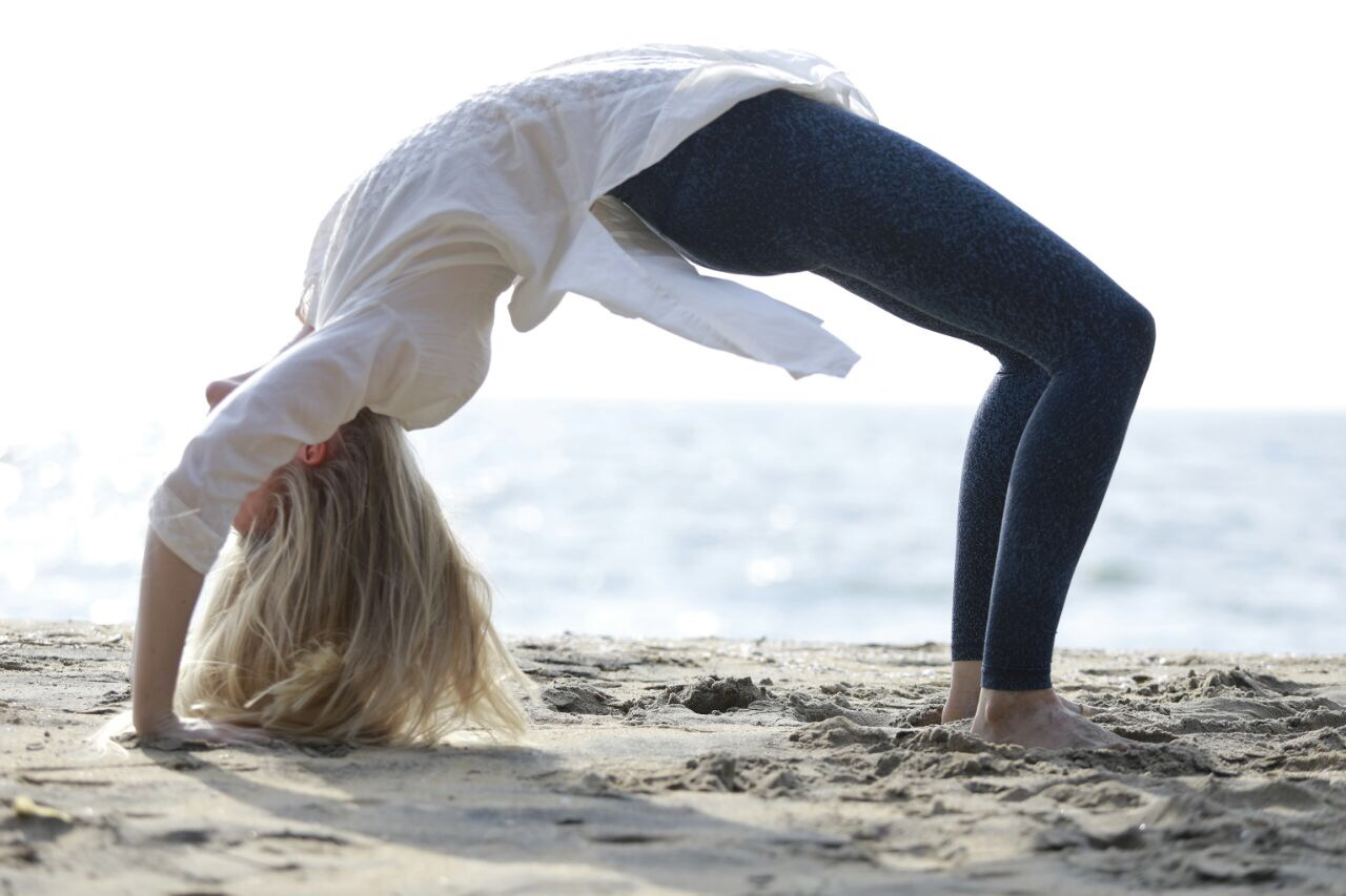 A Blonde Woman Traveling Alone in India and doing yoga on the beach - Photo credit:  Shyamlal Photography