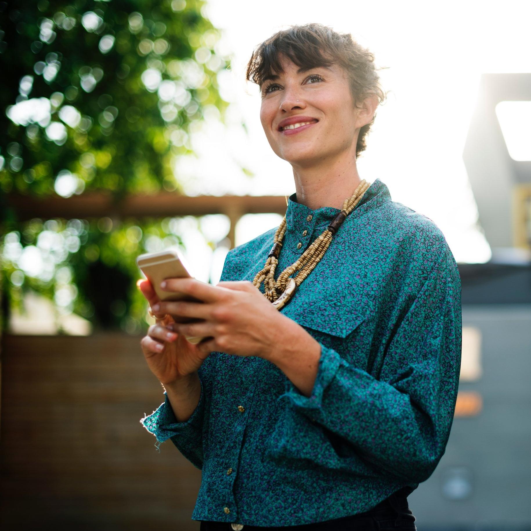 Woman with phone - rawpixel-com.jpg