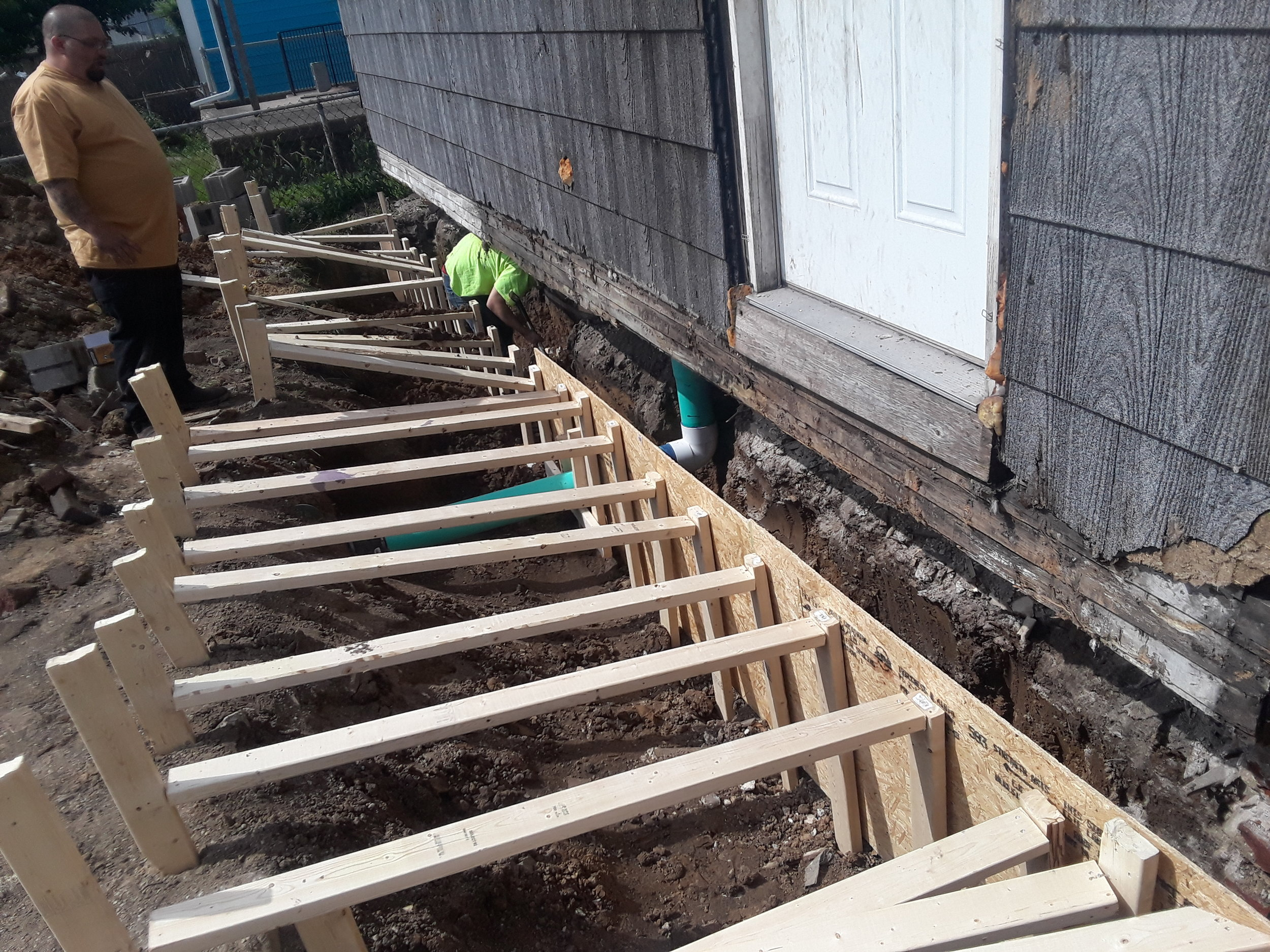 Restoration - This house had a redbrick foundation that fell over and after inspecting how it fell we found out there was no footers. We had to dig under the home 3 feet and pour a new footer system restoring structural stability to their home.