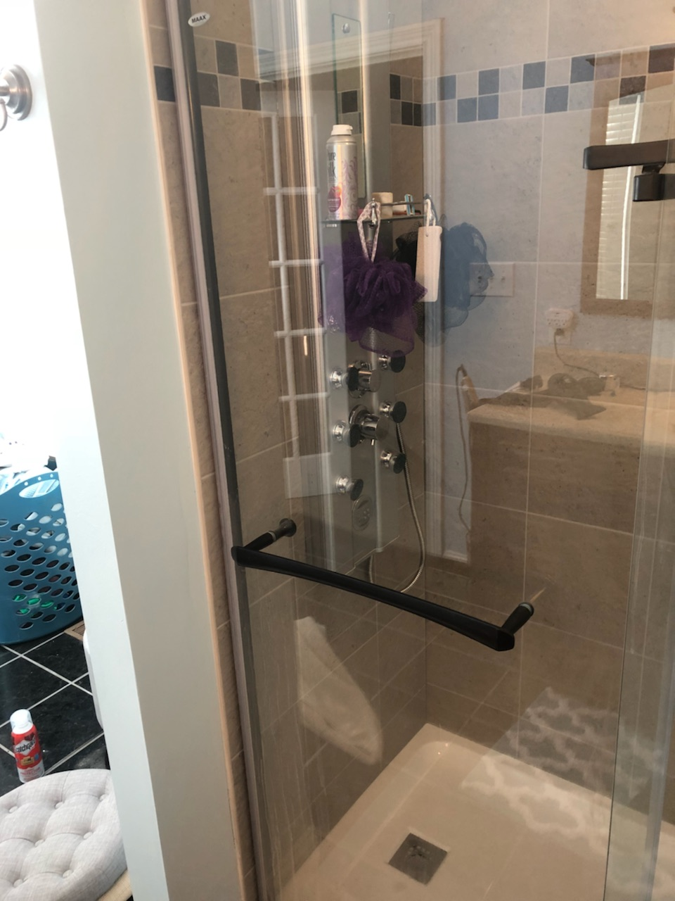 Remodeling - We moved wall back 1 foot and rebuilt a custom Shower with a body panel with 6 jets, shower head and a wand. We finally topped this Remodel off with glass Doors.